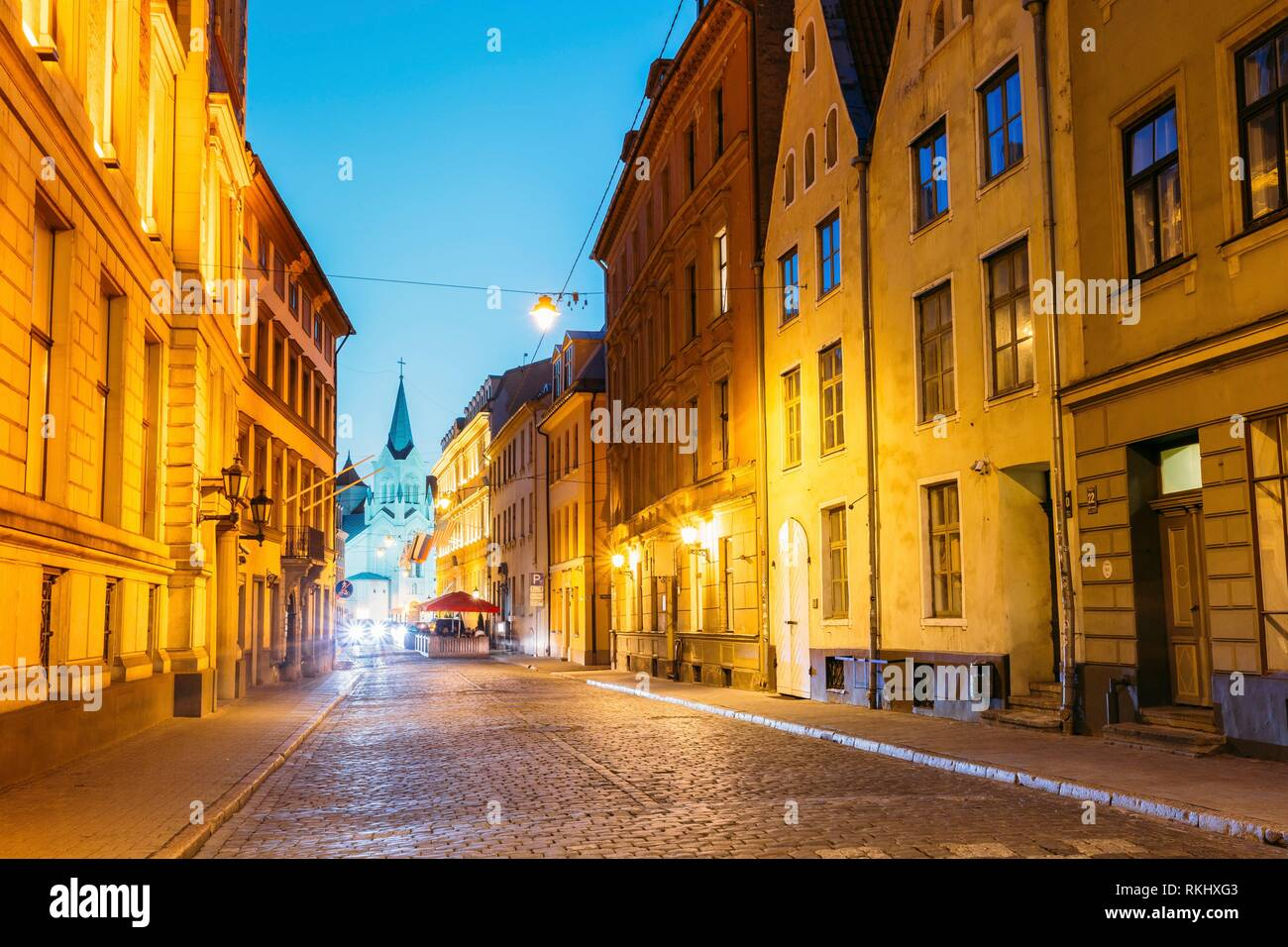 Riga Latvia. The White Tower With Pyramidal Spire Of Our Lady Of Sorrows Or Virgin Of Anguish Church, Ancient Catholic Church On Pils Street In - Stock Image