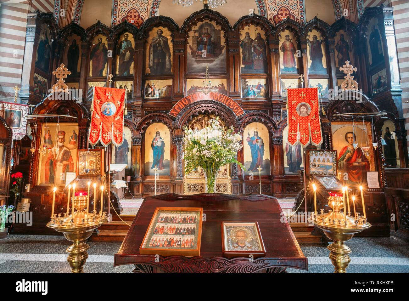 Vilnius, Lithuania: The Lectern Or Analogion With Two Icons Placed For Veneration By The Faithful In Orthodox Church Of St. Nicholas. - Stock Image