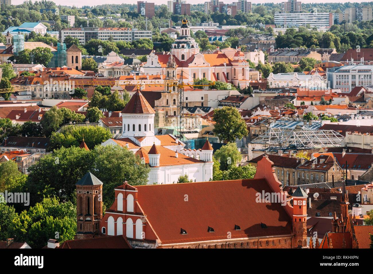Vilnius, Lithuania. View Of Church Of St. Casimir, Church Of Blessed Virgin Mary Of Consolation, Cathedral Of Theotokos, Church Of St. Francis And Stock Photo