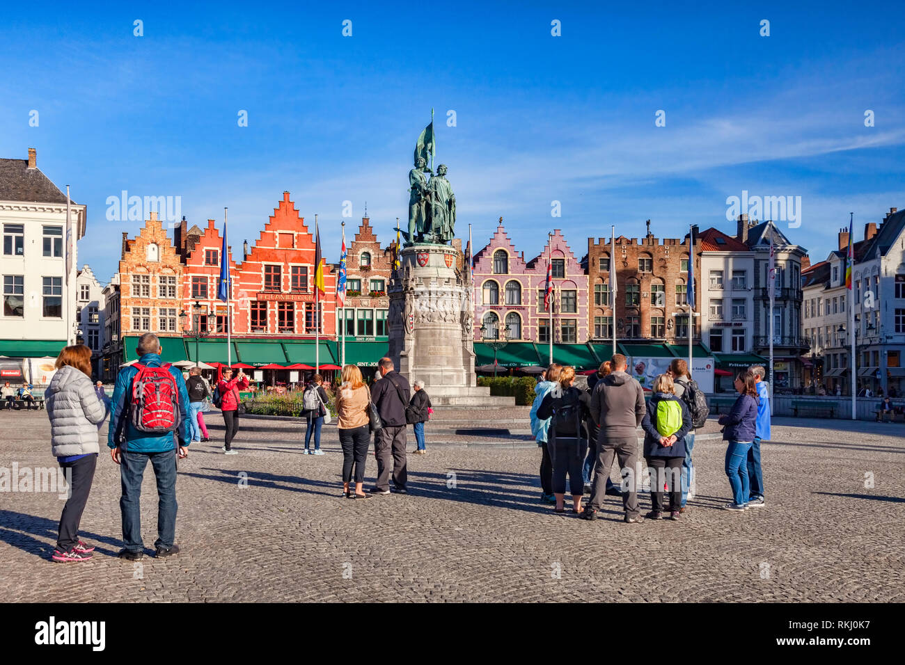 25 September 2018: Bruges, Belgium - Tourists in the Market Square on a sunny afternoon. Stock Photo