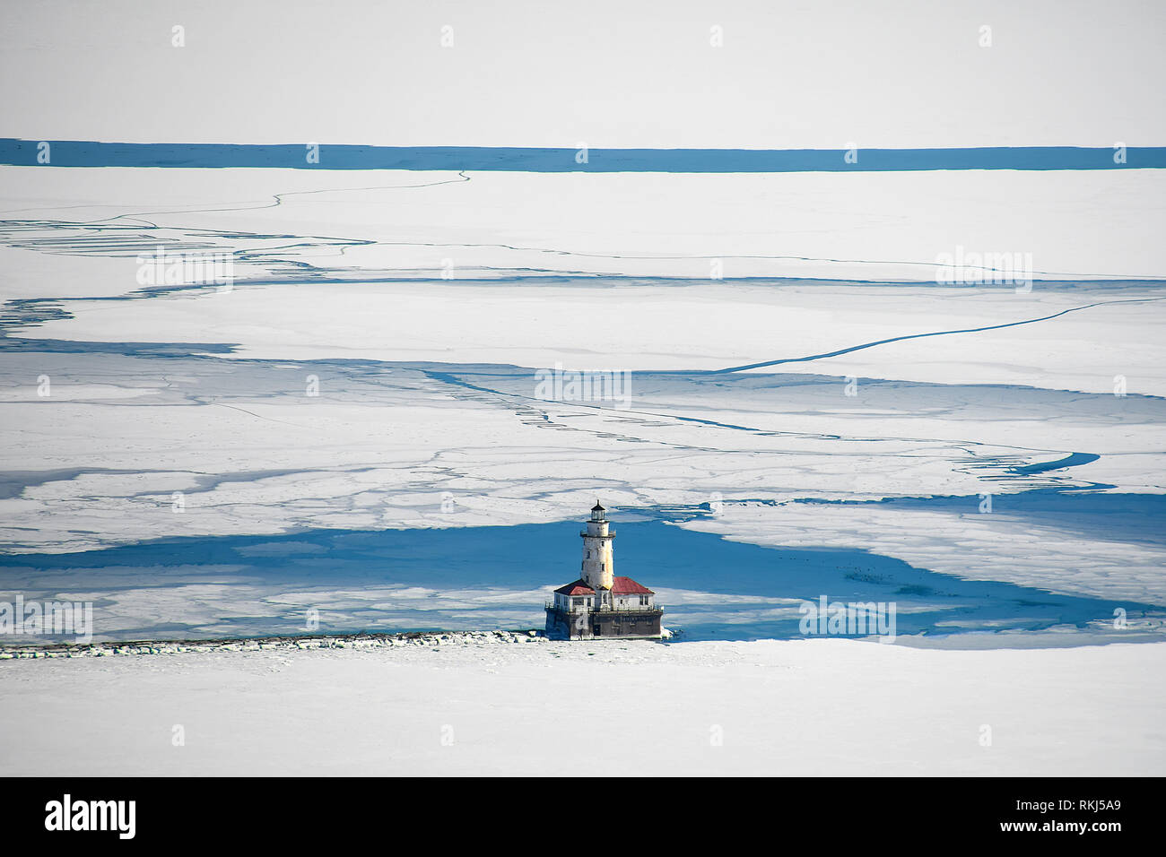 aerial view of Chicago lighthouse on Lake Michigan in ice and snow Stock Photo