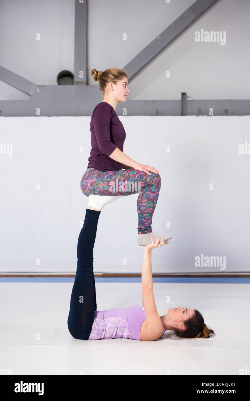 Two Friends Doing Acro Yoga High Resolution Stock Photography and