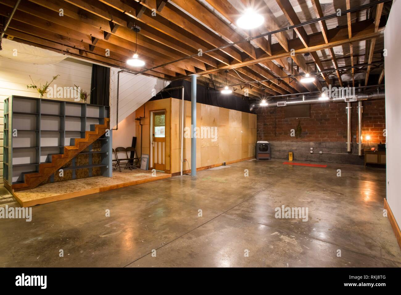 Interior space at a yoga studio ready for students to bring their mats and practice yoga. - Stock Image