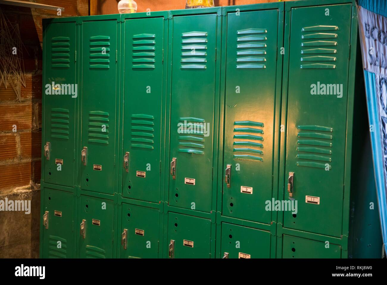 Repurposed green, vintage lockers at a yoga studio in the changing area indoors. - Stock Image
