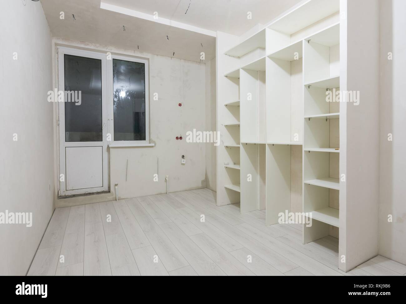 Repair in the living room of new buildings, built-in wardrobe and on the floor laminated panels. - Stock Image