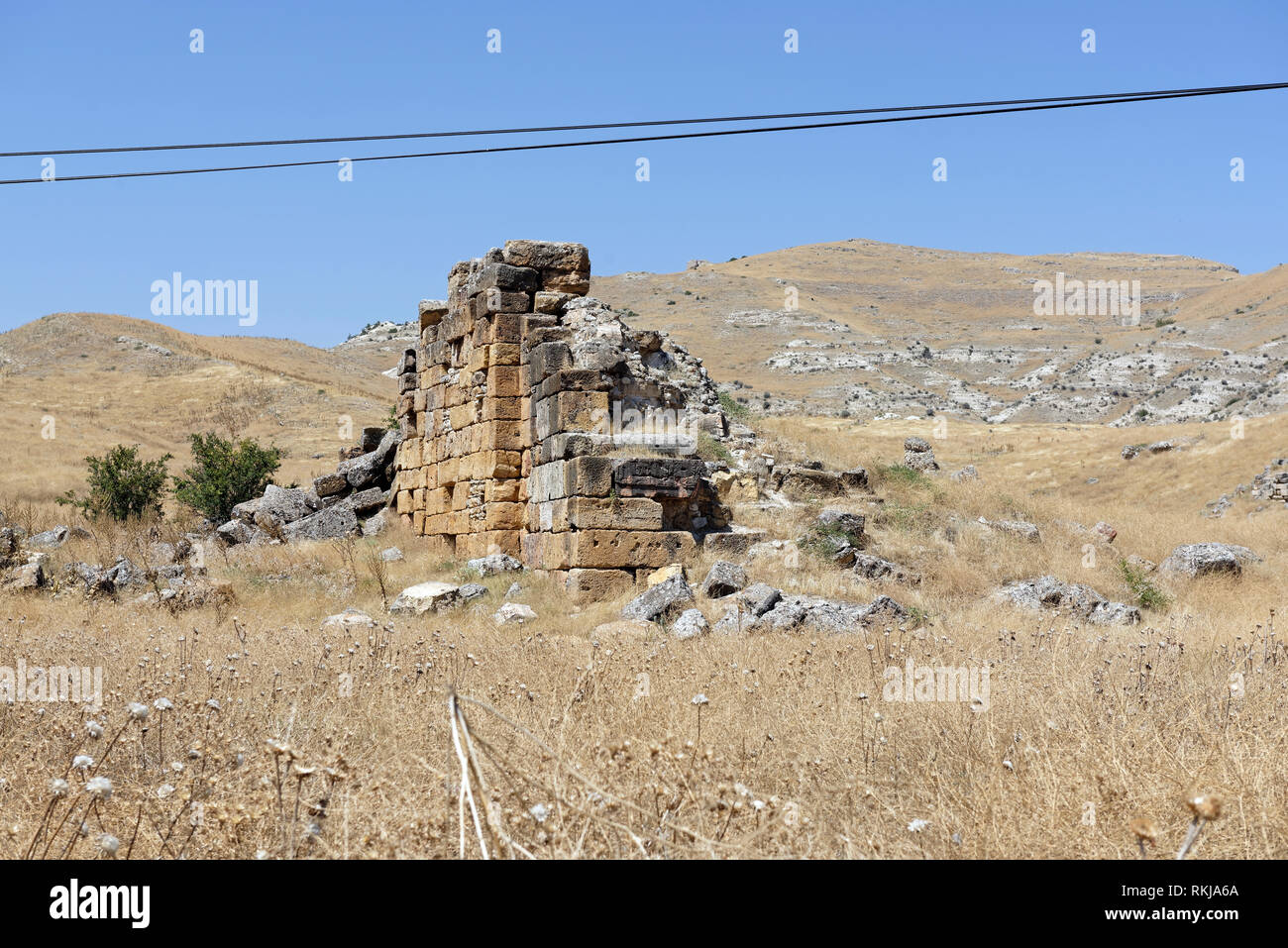 The bouleuterion (council hall), of which only a section of the structure walls remains, Tripolis on the Meander, Yenicekent, Turkey. Stock Photo