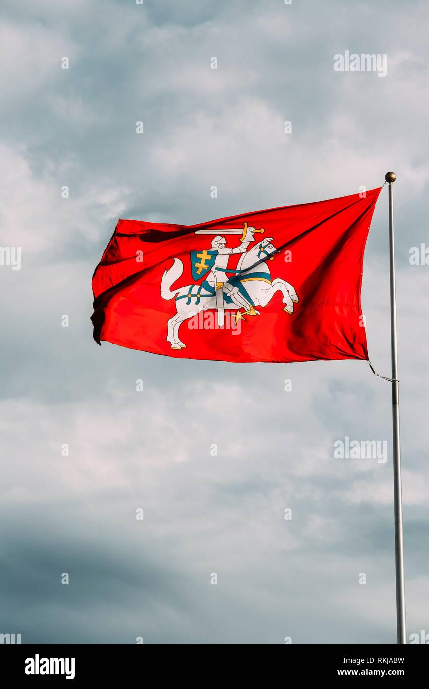 Coat Of Arms Of Lithuania On The State (Historical) Flag Of Lithuania, Waving On Flagpole At Sky Background. - Stock Image