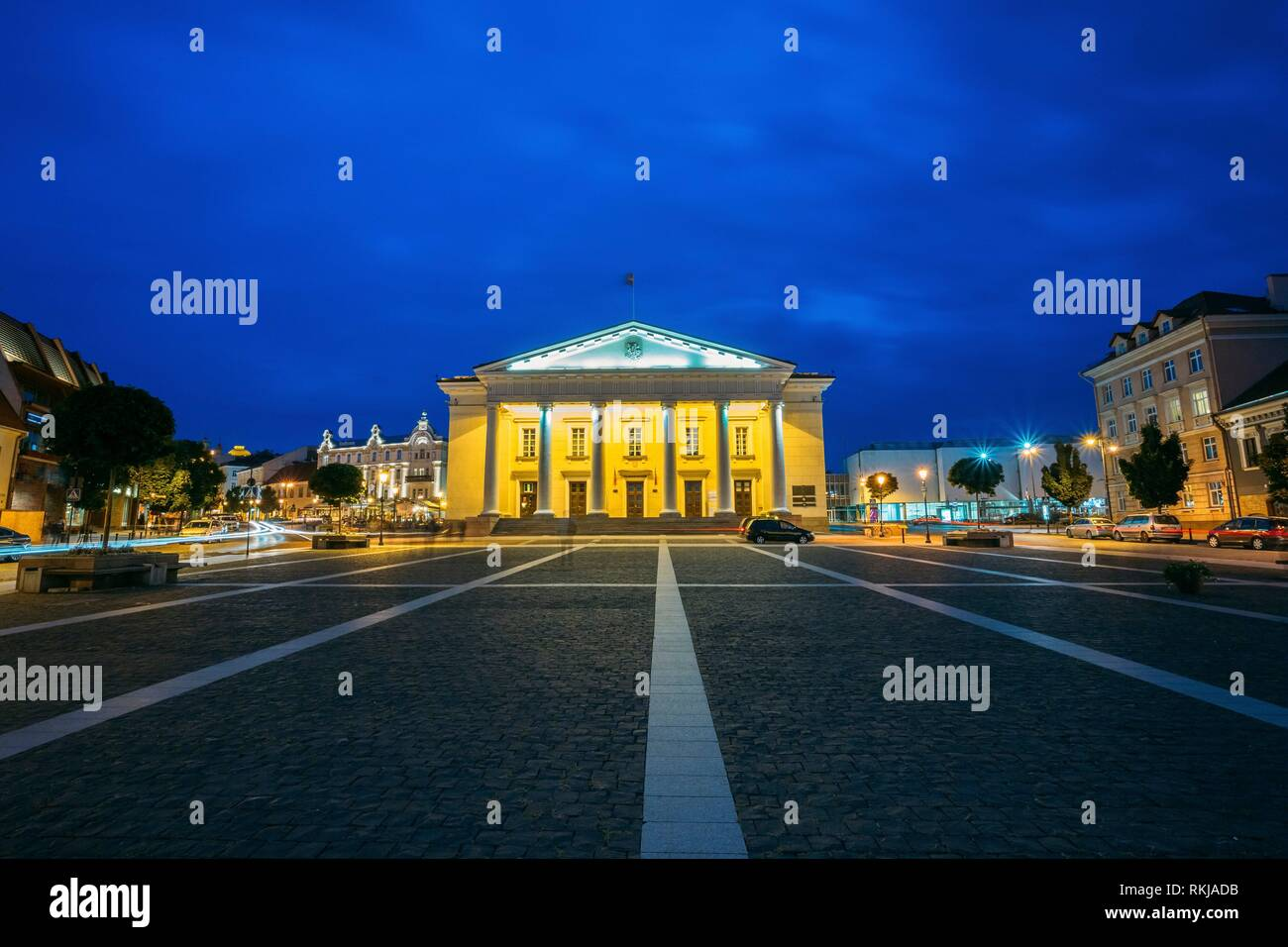 Vilnius, Lithuania. Main Facade Of Town Council In Evening Illumination, Administrative Building With Columns On Didzioji Street In Old Town Under - Stock Image