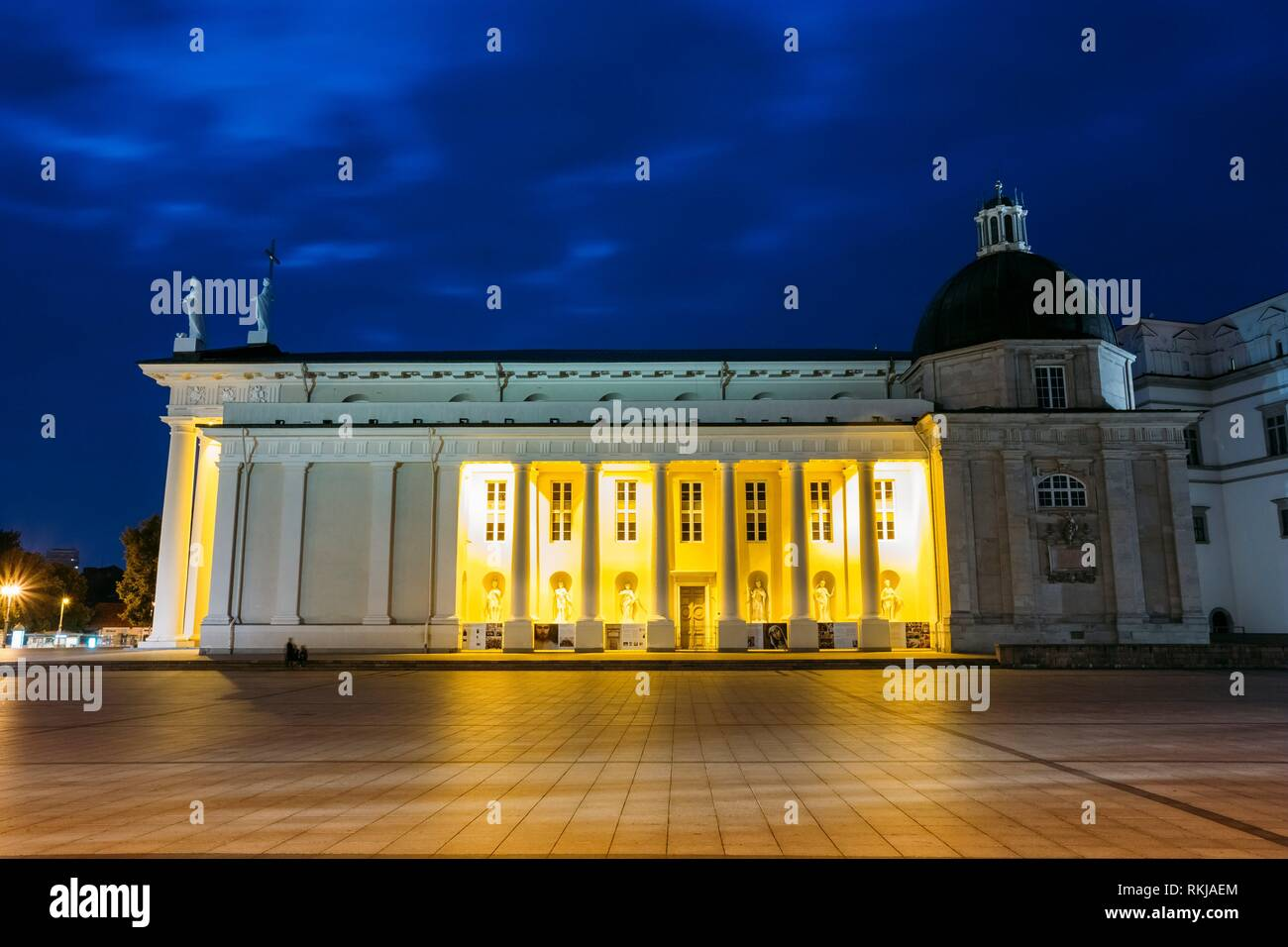 Vilnius, Lithuania. Night Or Evening View Of Cathedral Basilica Of St. Stanislaus And St. Vladislav At The Cathedral Square. Blue Cloudy Sky - Stock Image