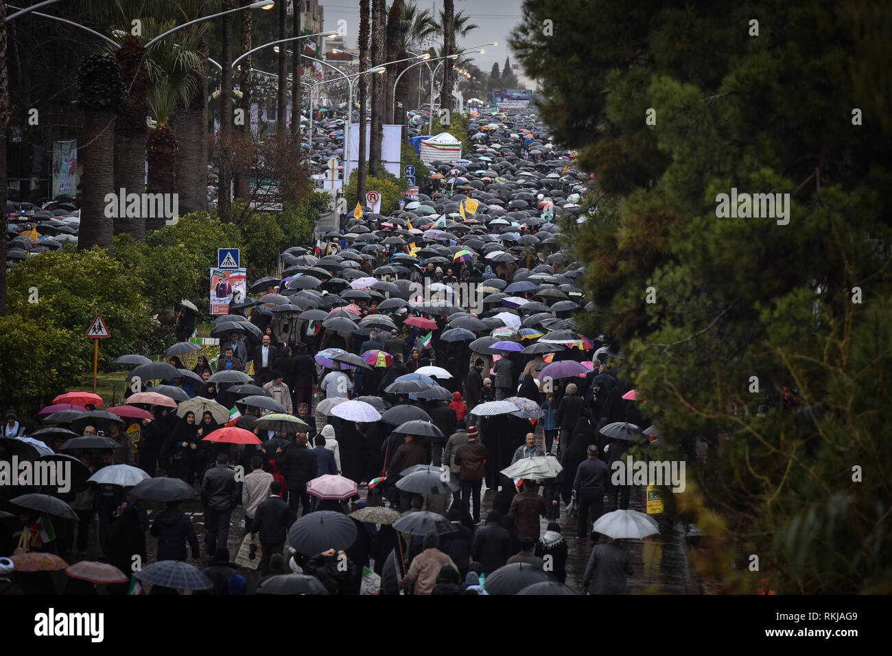 Iranians attend a ceremony celebrating the 40th anniversary of their Islamic Revolution, Shiraz city in Fars province, Iran, Monday. Feb. 11, 2019. Hundreds of thousands of people poured out onto the streets of Shiraz and other cities, towns and provinces across Iran, marking the date 40 years ago that is considered as victory day in the country's 1979 Islamic revolution. - Stock Image