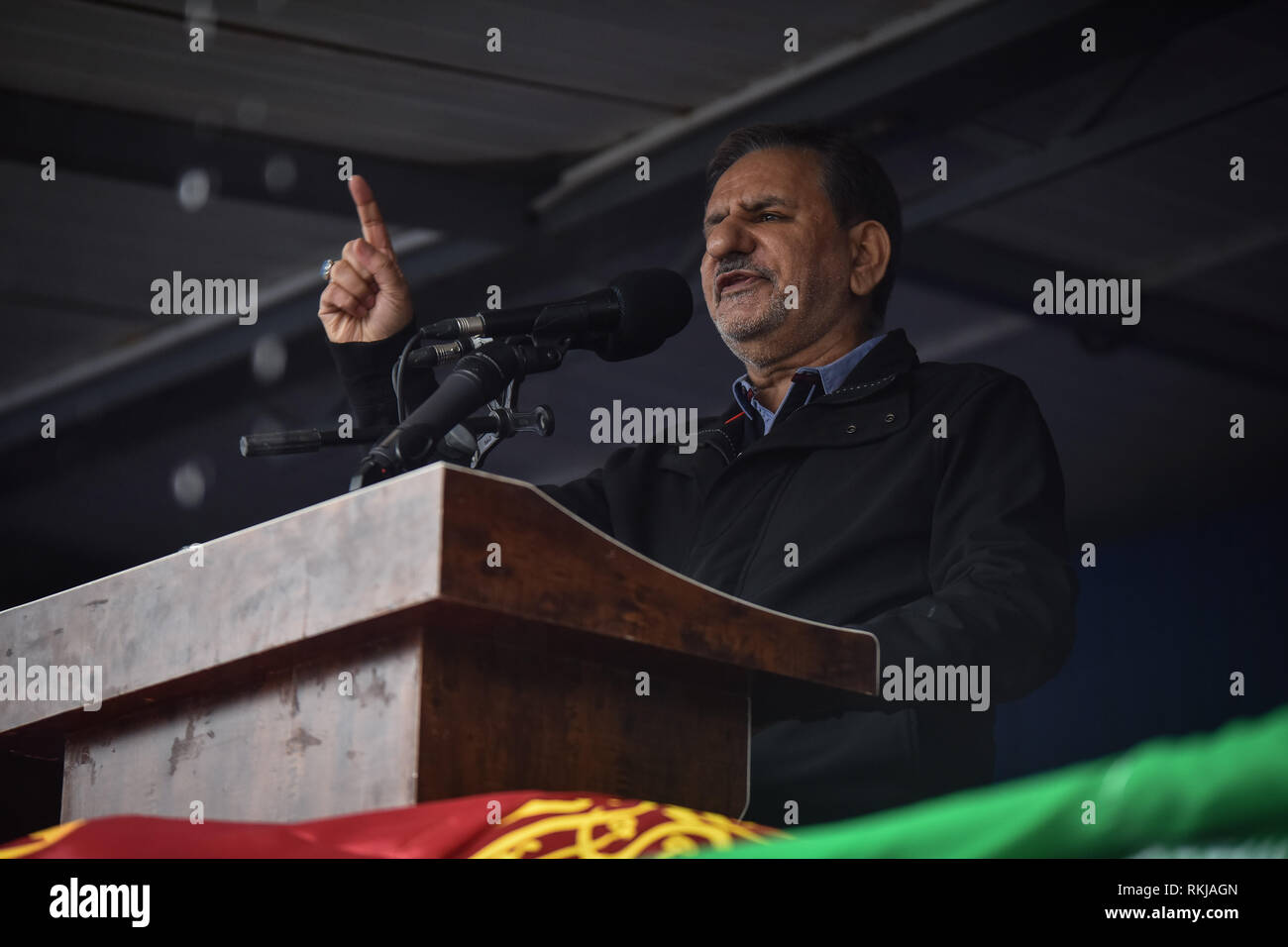 Iranians attend a ceremony celebrating the 40th anniversary of their Islamic Revolution, Shiraz city in Fars province, Iran, Monday. Eshaq Jahangiri Kouhshahi is an Iranian politician and first vice president of Hassan Rouhani's government speaks during a ceremony celebrating the 40th anniversary ofthe Islamic revolution at Shiraz city of Iran. Feb. 11, 2019. Hundreds of thousands of people poured out onto the streets of Shiraz and other cities, towns and provinces across Iran, marking the date 40 years ago that is considered as victory day in the country's 1979 Islamic revolution. - Stock Image