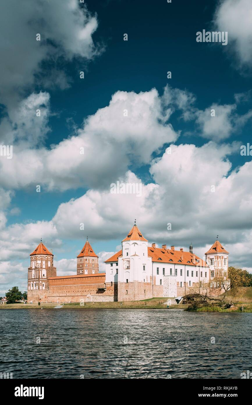 Mir, Belarus. Mir Castle And Lake In Summer Sunny Day. Cultural Monument, UNESCO Heritage. - Stock Image