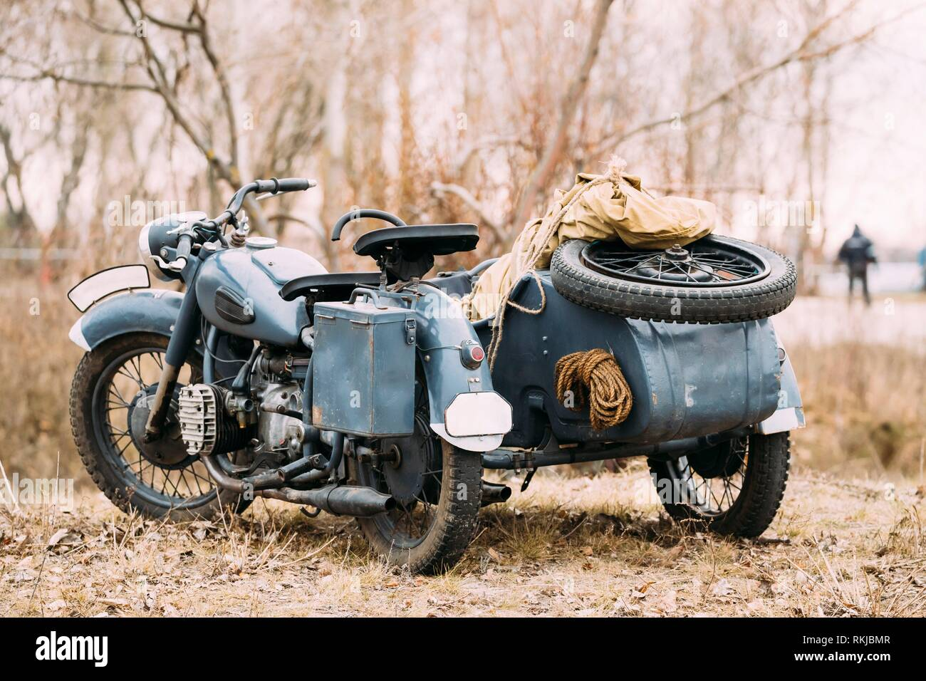 The Old Rarity Tricar, Three-Wheeled Gray Motorcycle With A Sidecar Of German Forces Of World War 2 Time Standing As An Exhibit In Summer Sunny Park. - Stock Image