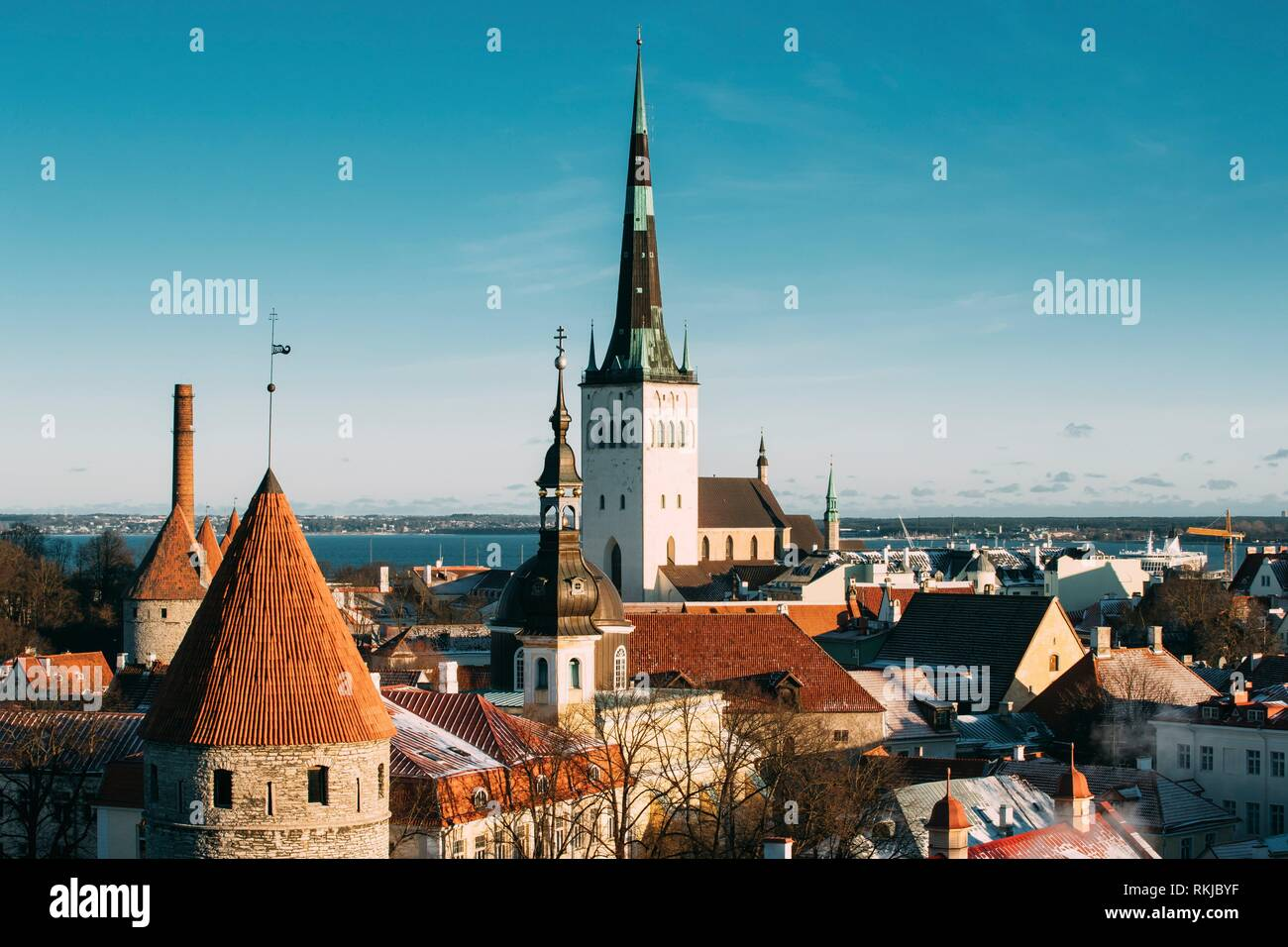 Tallinn, Estonia. Part Of Tallinn City Wall With Towers, At The Top Of Photo There Is Tower Of Church Of St. Olaf Or Olav. Popular Destination Scenic. - Stock Image