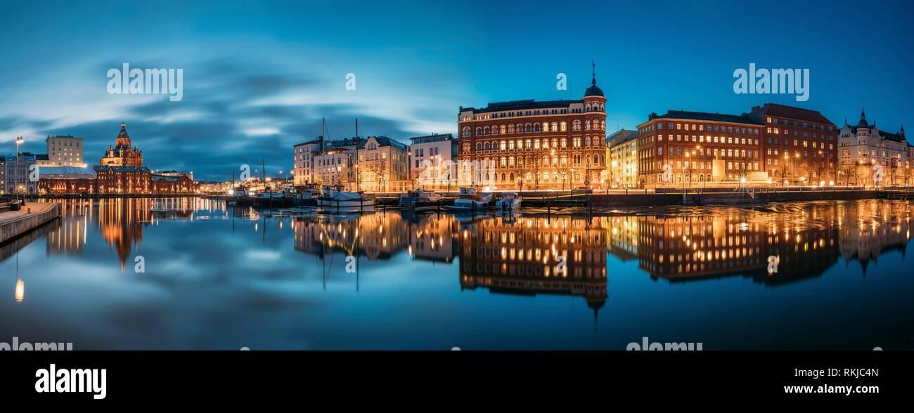 Helsinki, Finland. Panoramic View Of Kanavaranta Street With Uspenski Cathedral And Pohjoisranta Street In Evening Night Illuminations. - Stock Image