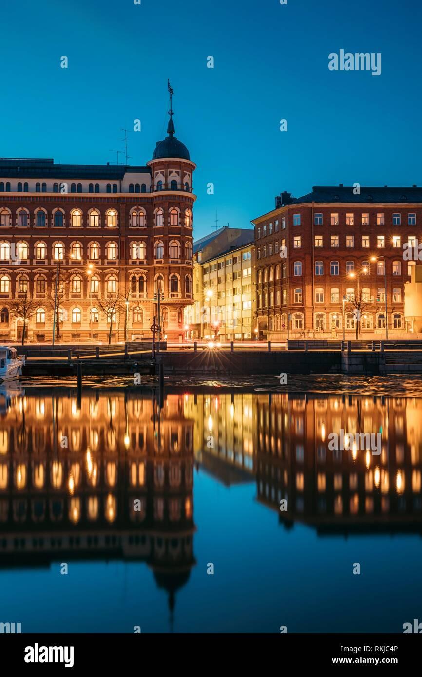 Helsinki, Finland. Crossroad Of Pohjoisranta And Kirkkokatu Street In Evening Or Night Illumination. - Stock Image
