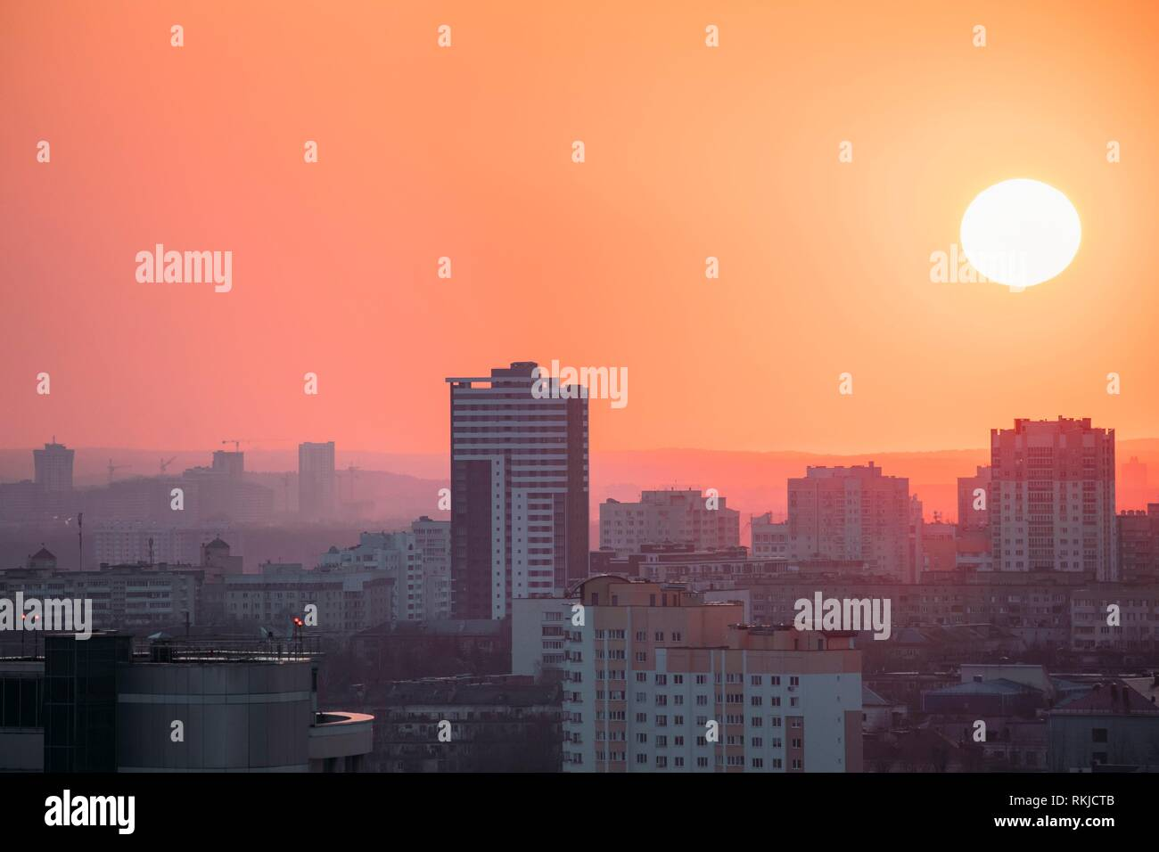 Minsk, Belarus. View Of Houses In Residential Area In Sunset Sunrise Time With Full Moon. - Stock Image