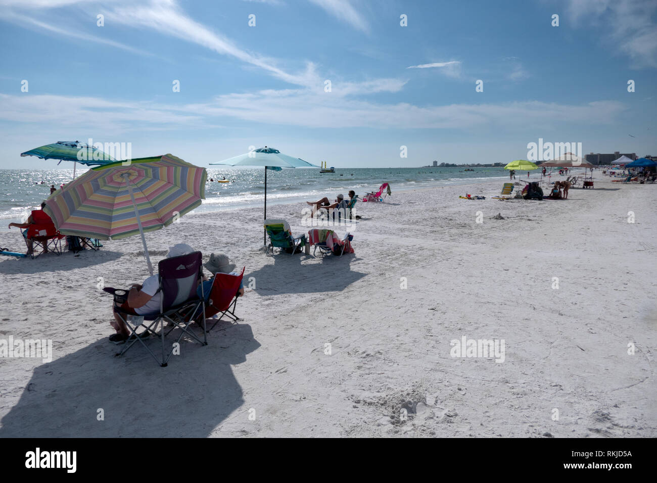 People relaxing on holidays on Siesta Key beach in Sarasota, Florida, USA. Tourists on summer vacations near the sea. American landscape and recreatio - Stock Image