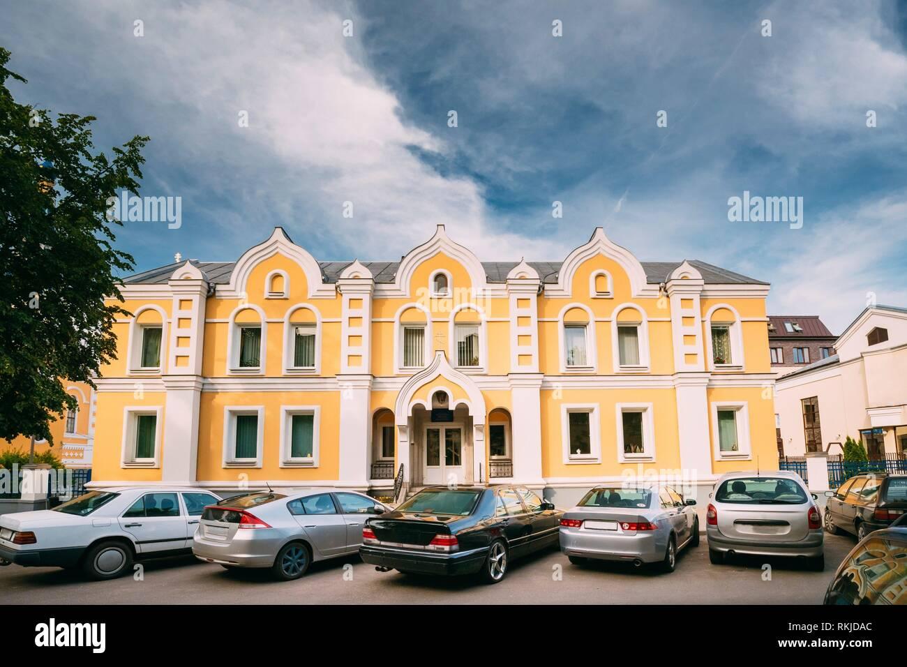 Brest, Belarus. Cars Parking Near Building Of Sunday School At St. Nicholas Church On Sovietskaya Street. - Stock Image