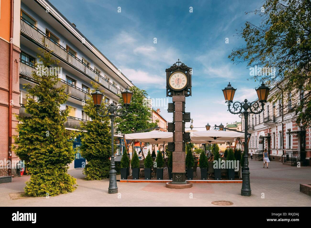 Brest, Belarus. Two-Sided Clock In Old-Fashioned Decoration With Arms Of City Of Different Times In Form Of A Six-Meter Bronze Monument On Pedestrian - Stock Image