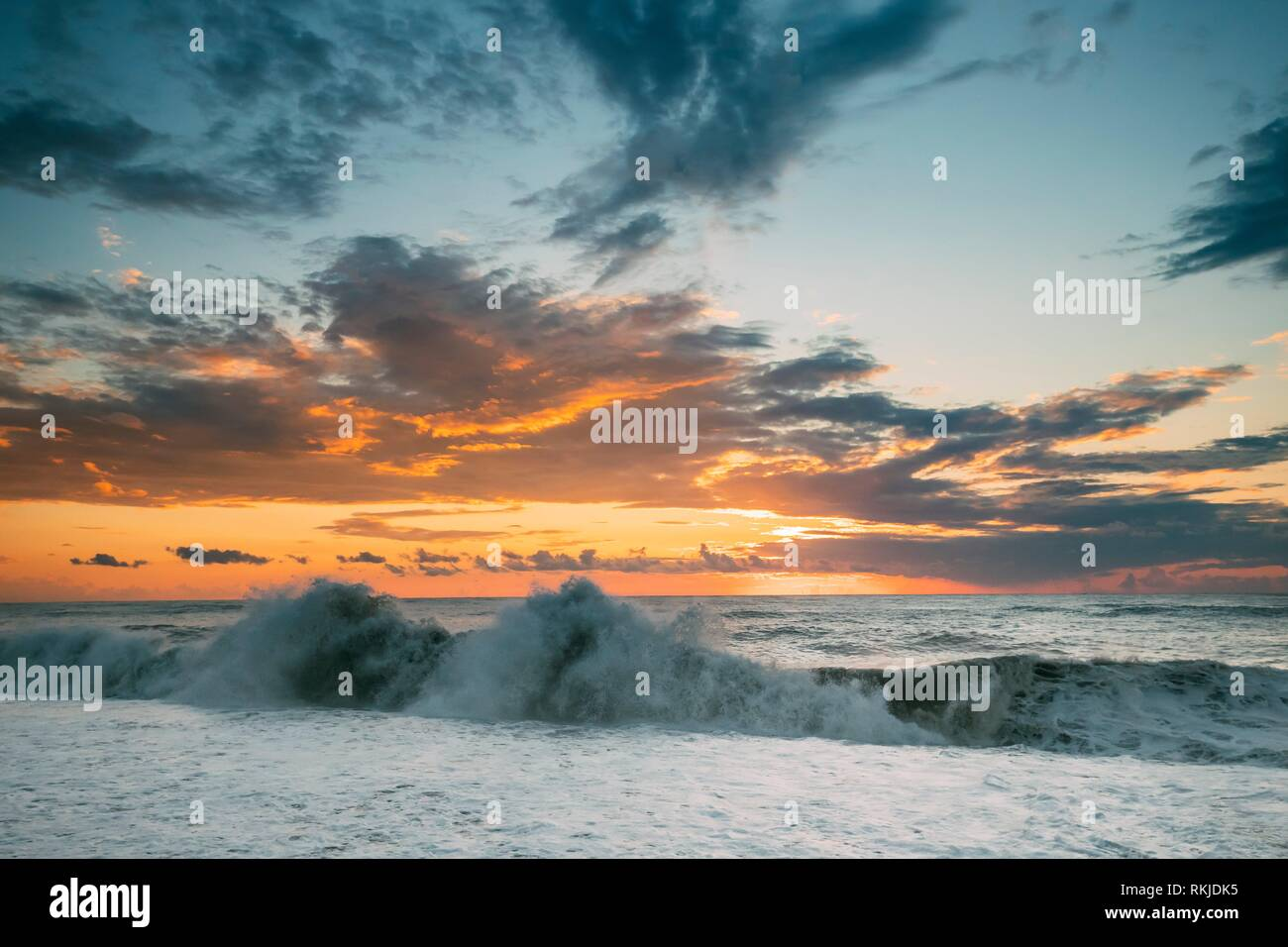 Sea Or Ocean Waves During Storm Colorful Sunset Or Sunrise Sky Background. Stock Photo