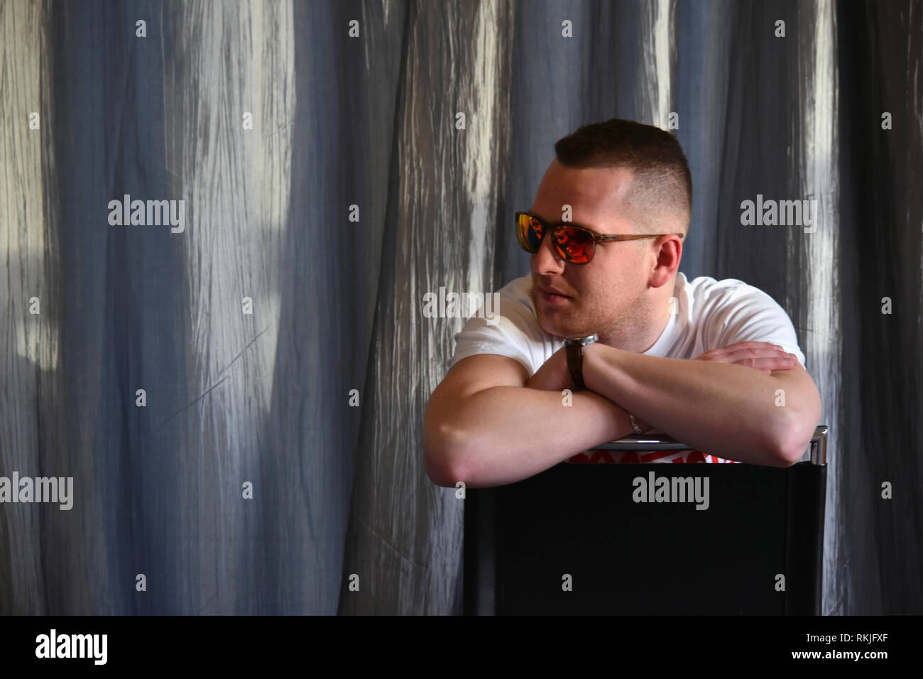 Sitting in front of the lens - Stock Image