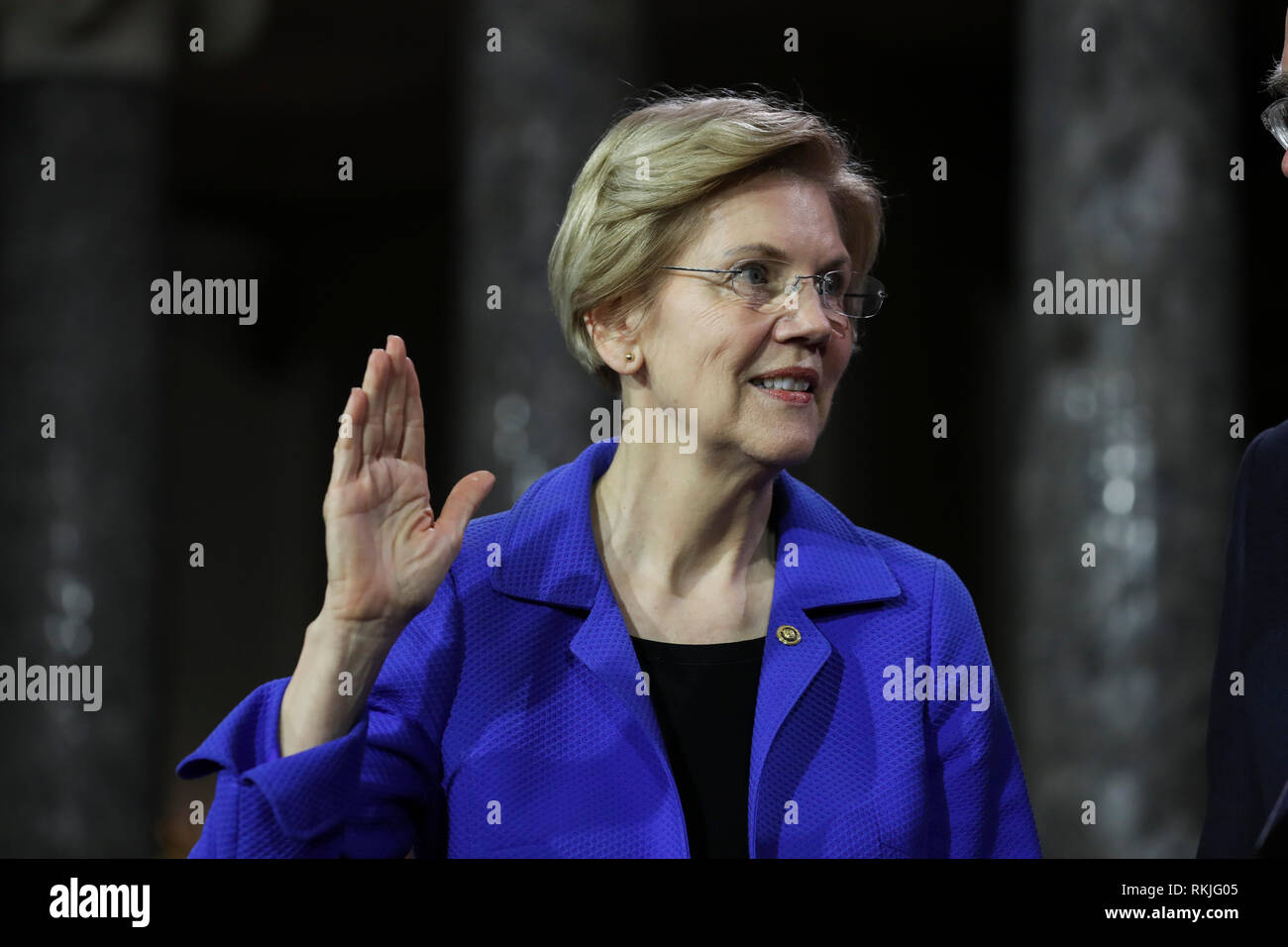 US Senator Elizabeth Warren, Democrat of Massachusetts, is sworn in by Vice President Mike Pence on Capitol Hill in Washington, DC on January 3, 2019. Stock Photo