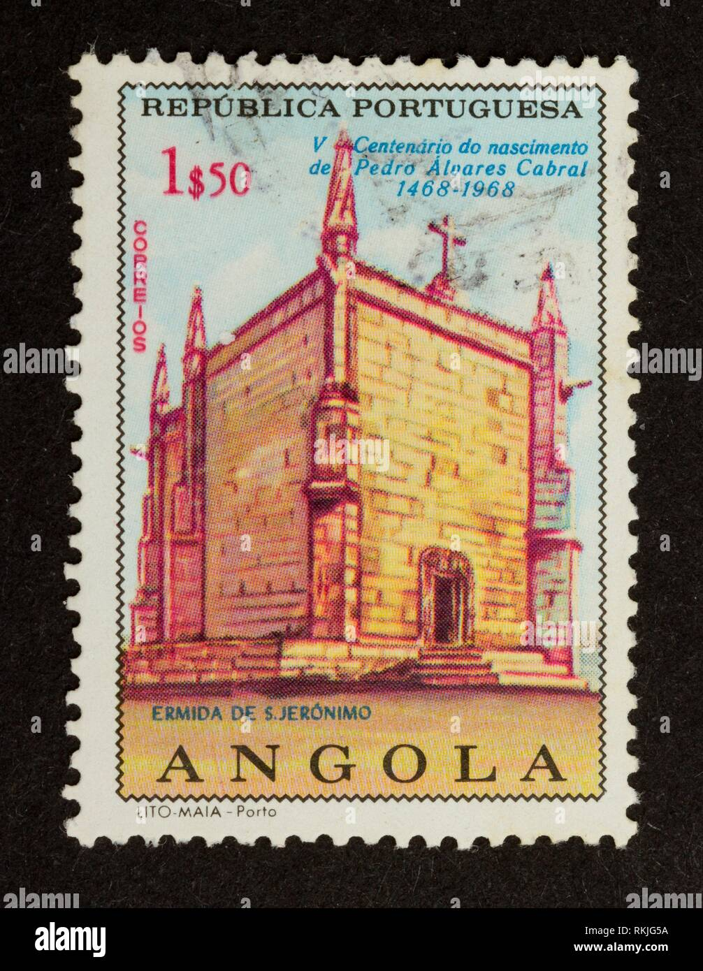 ANGOLA - 1968: Stamp printed in Angola shows an old building, 1968. - Stock Image
