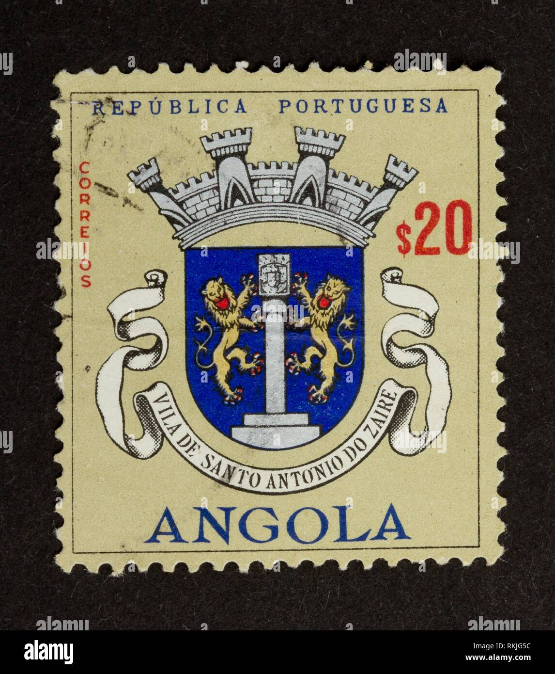 ANGOLA - CIRCA 1970: Stamp printed in Angola shows two lions on a shield, 1970. - Stock Image