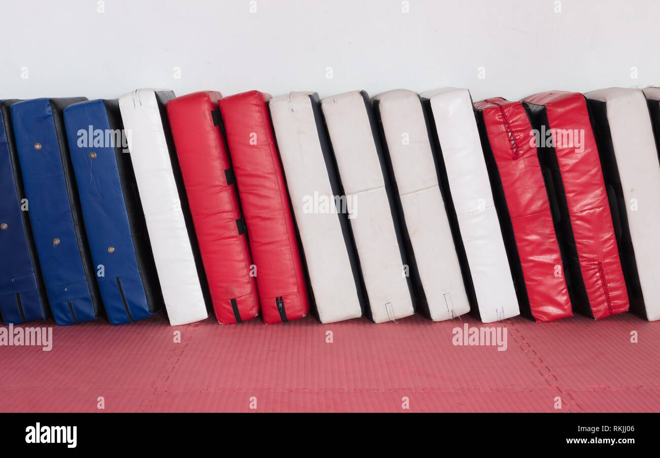 Large punching pads in a row, red white and blue. - Stock Image