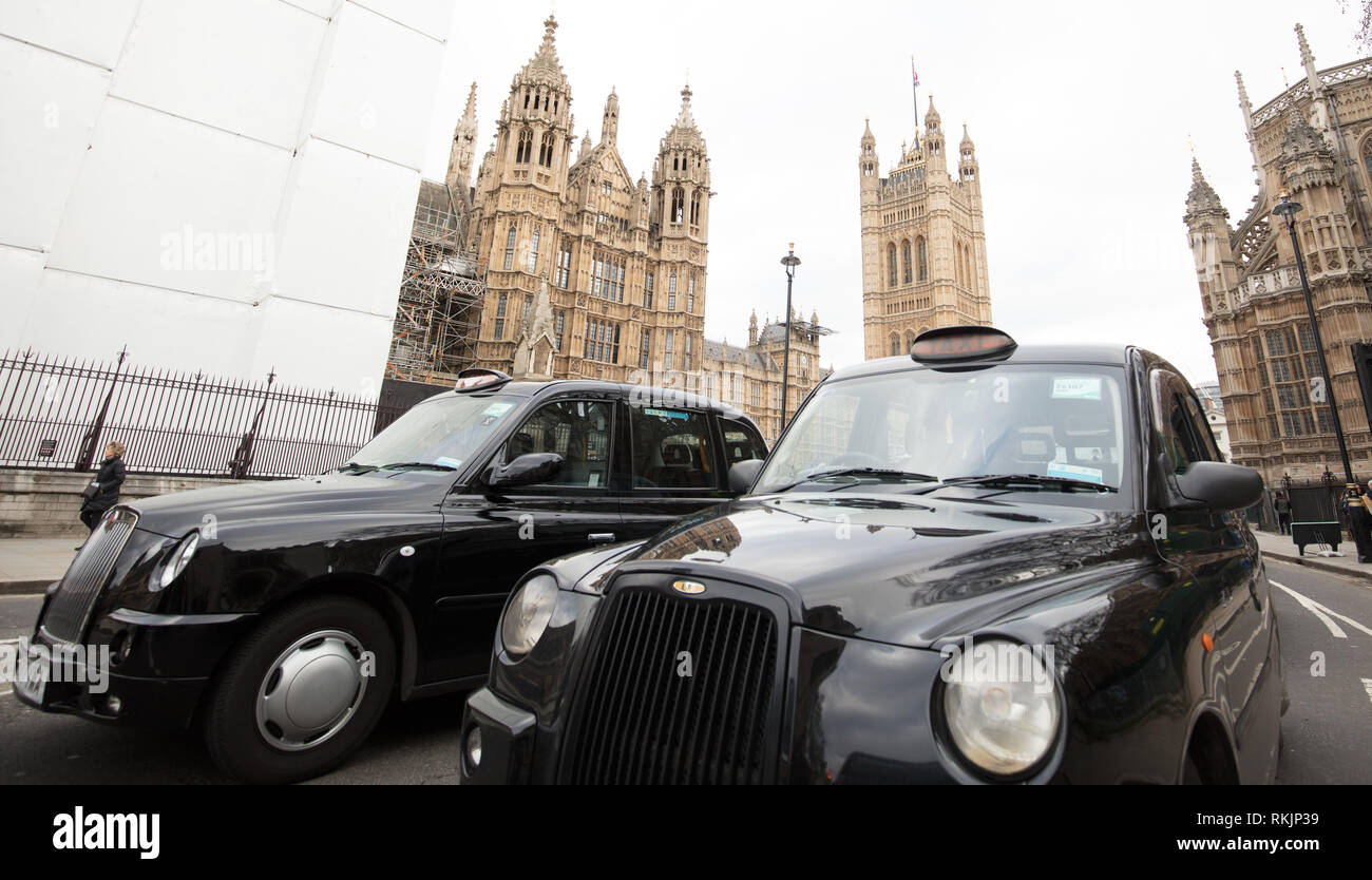 London, UK. 11th February 2019. London licensed taxi drivers bring traffic to standstill around Parliament Square, Westminster, London, protesting against policies of the Transport for London (TfL) and Mayor Khan. Credit: Joe Kuis / Alamy Live News - Stock Image