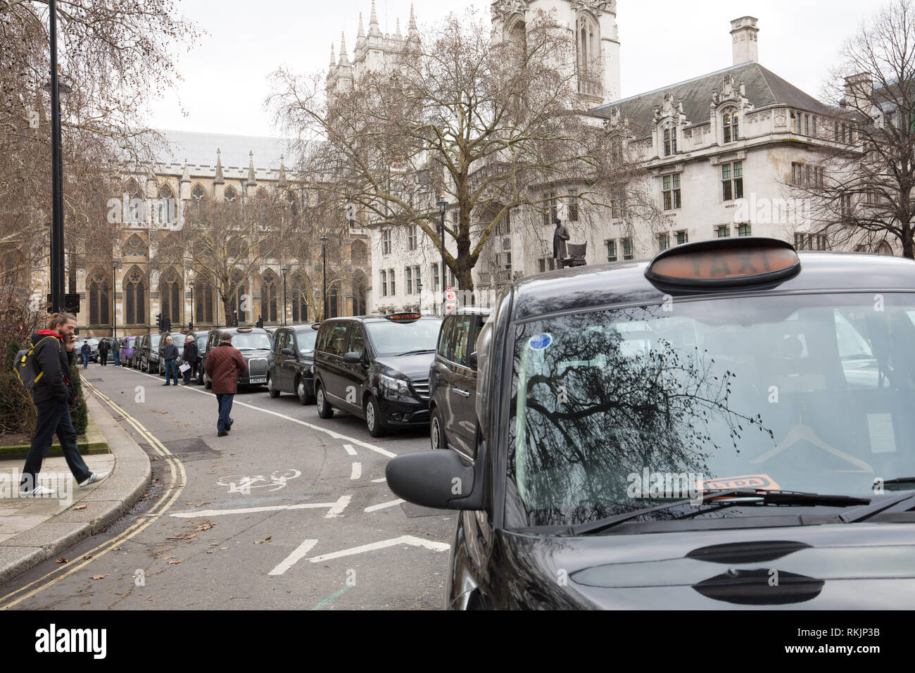 London, UK. 11th February 2019. Taxis standing in protest around Trafalagar Square near Westminster Abbey, today,  because London licensed taxi drivers bring traffic to standstill around Parliament Square, Westminster, London, protesting against policies of the Transport for London (TfL) and Mayor Khan. Credit: Joe Kuis / Alamy Live News - Stock Image
