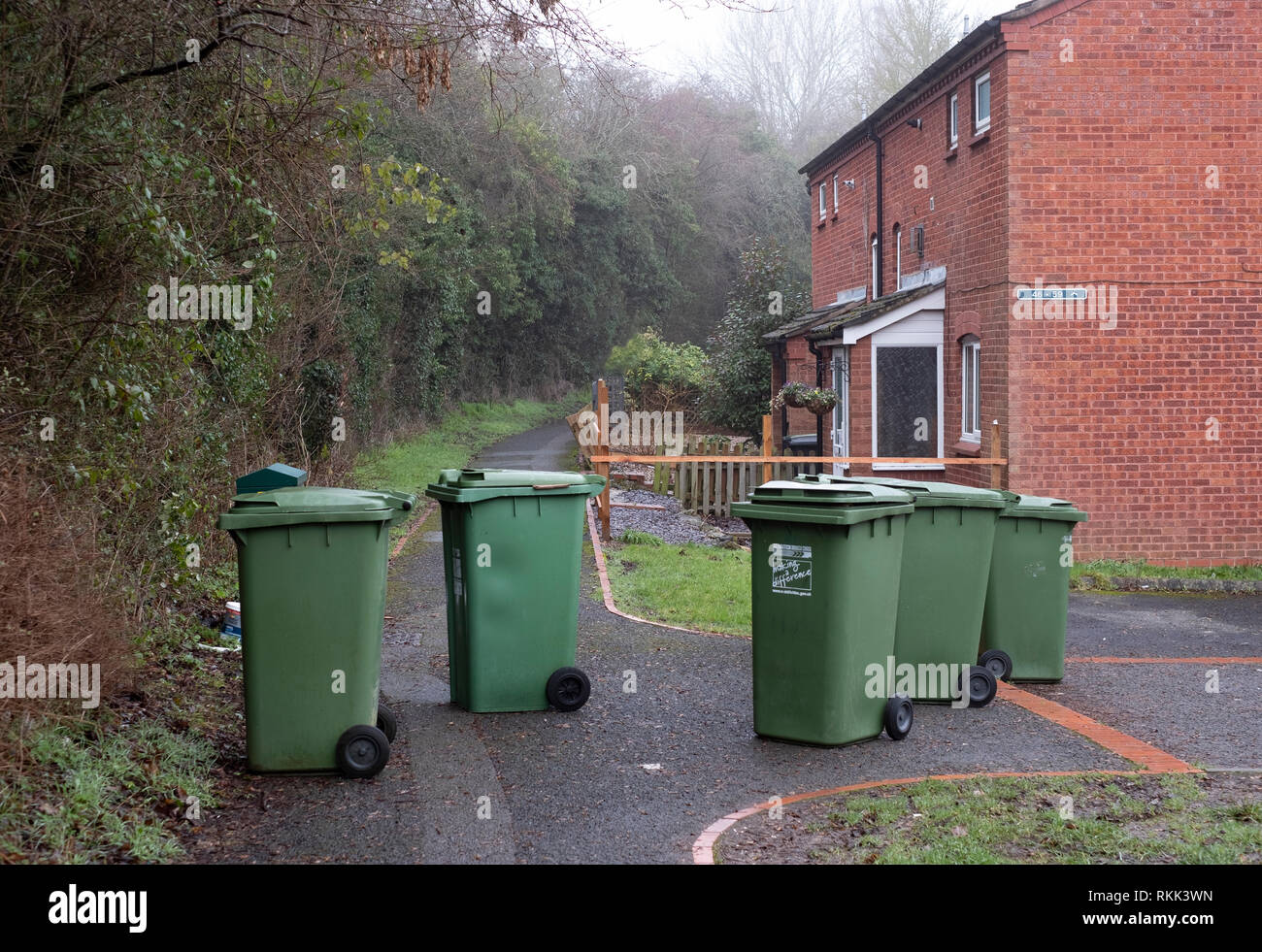 Bin day.  Domestic green recycling bins out for collection on a housing estate in Worcestershire, UK. Stock Photo