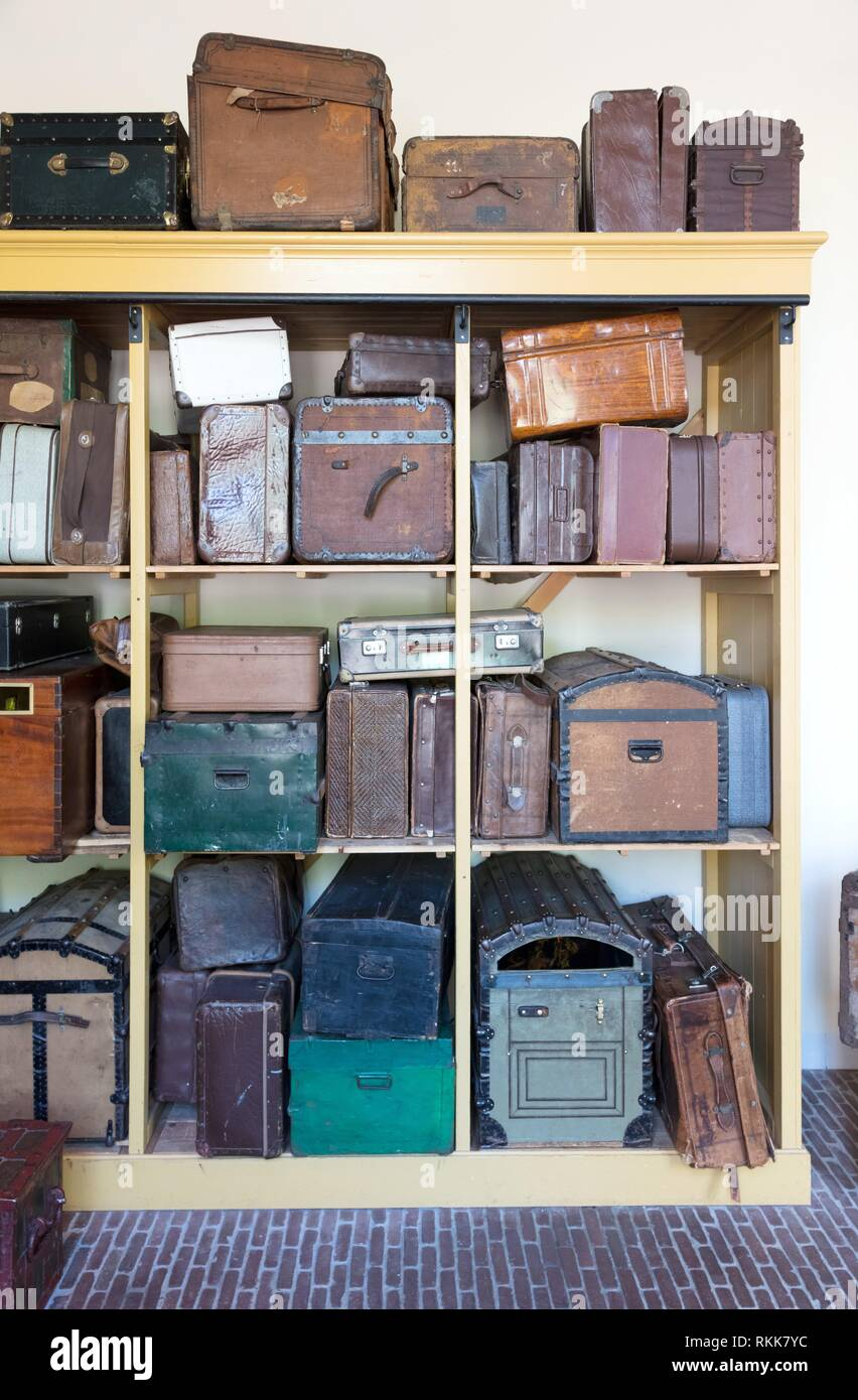 Storage of vintage suitcases - Different sizes and colors. - Stock Image