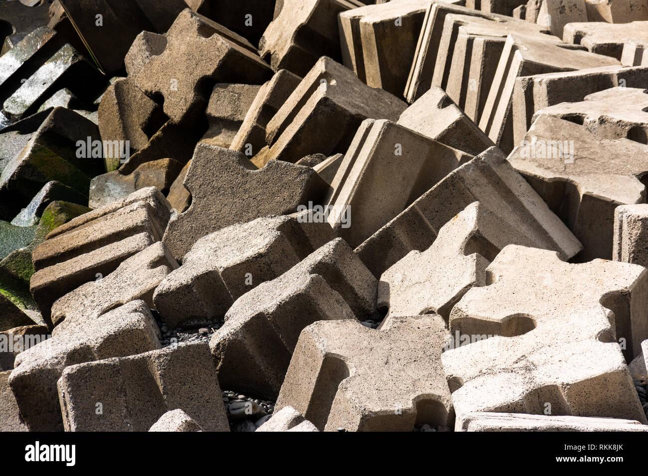 Concrete cubes as harbor attachment - Stock Image