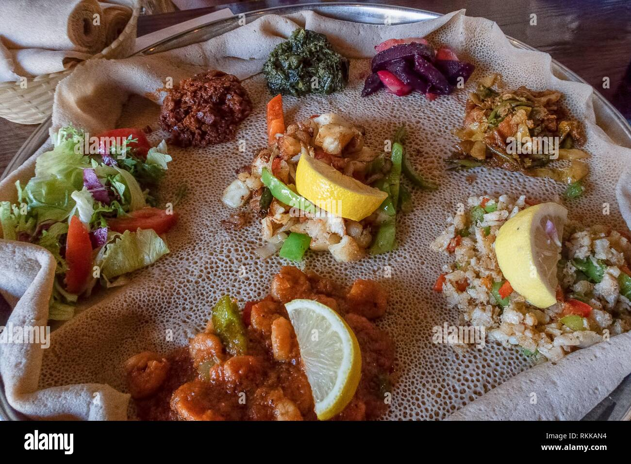 Injera is a sourdough flatbread made from teff flour. It is the national dish of Ethiopia, Eritrea, Somalia and Djibouti. - Stock Image