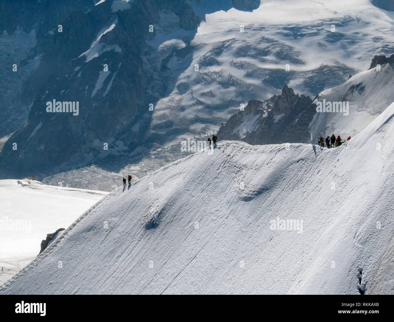 Trekkers on Aiguille Du Midi, in the french alps. - Stock Image