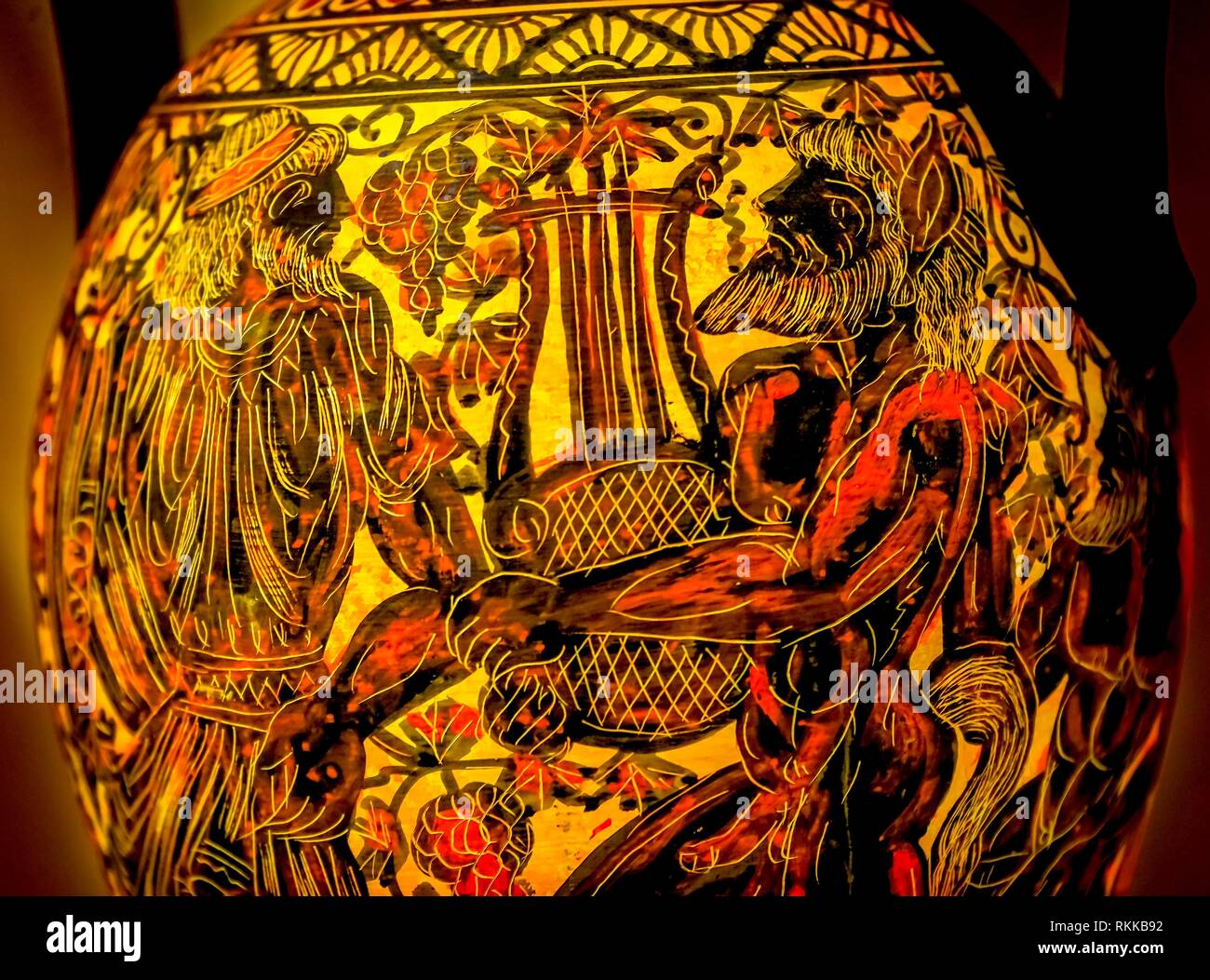 Apollo Giving Orpheus Lyre, Musical instrument, Greek Ancient Replica Pottery Chariot Athens Greece. - Stock Image