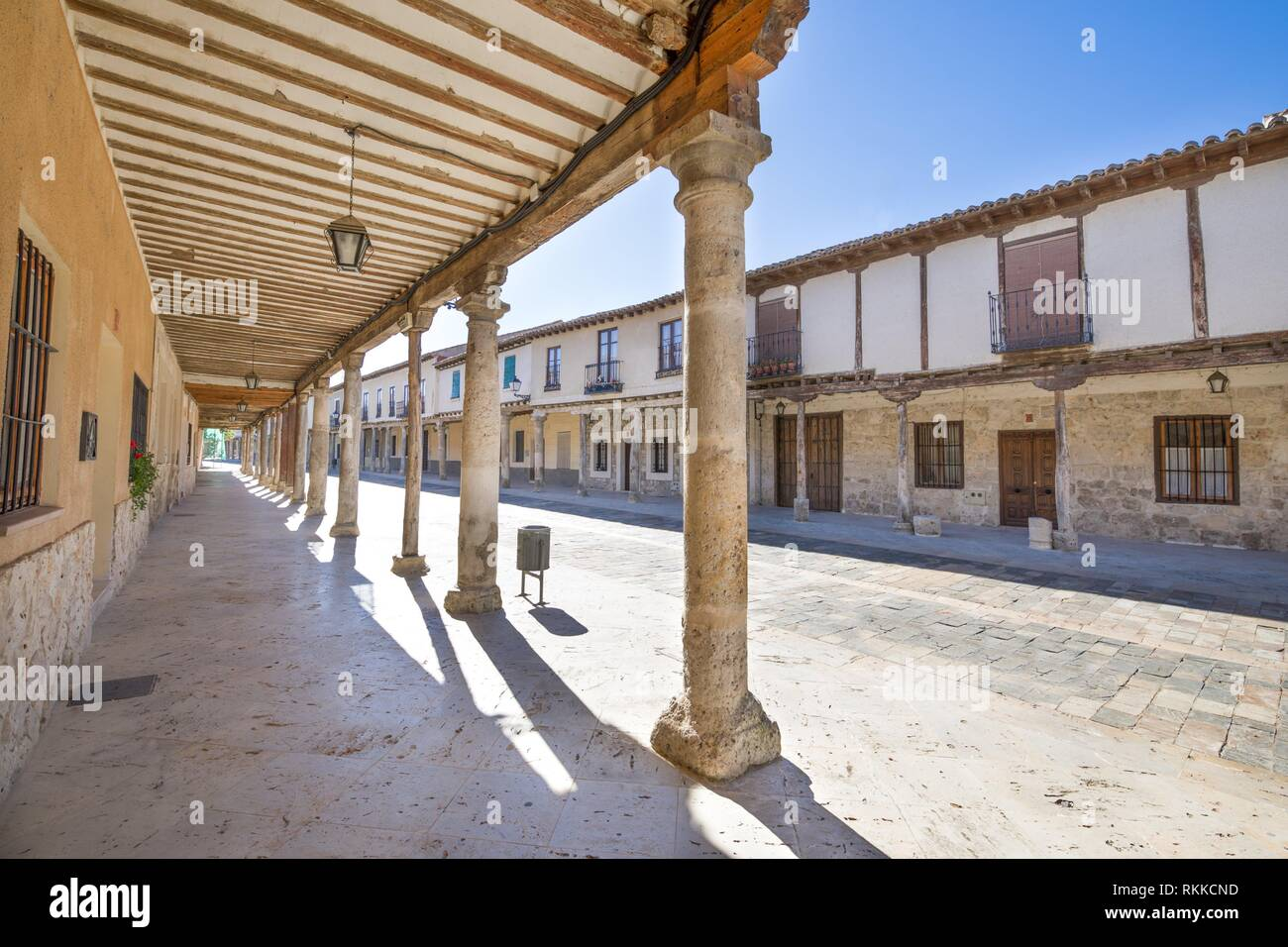 arcaded buildings, in medieval street, landmark and monument from seventeenth century, in Ampudia village, Palencia, Castile Leon, Spain, Europe. - Stock Image