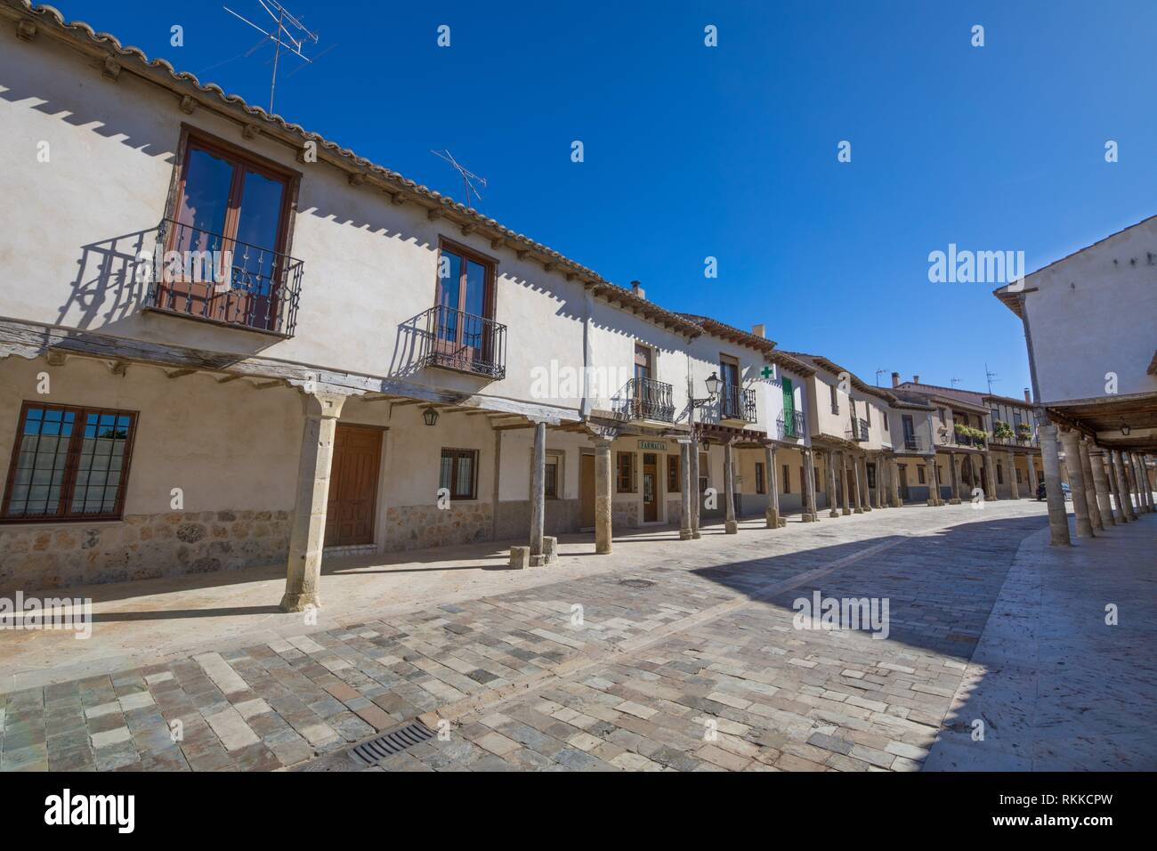 ancient pedestrian medieval street with arcaded buildings, landmark and monument from seventeenth century, in Ampudia village, Palencia, Castile - Stock Image