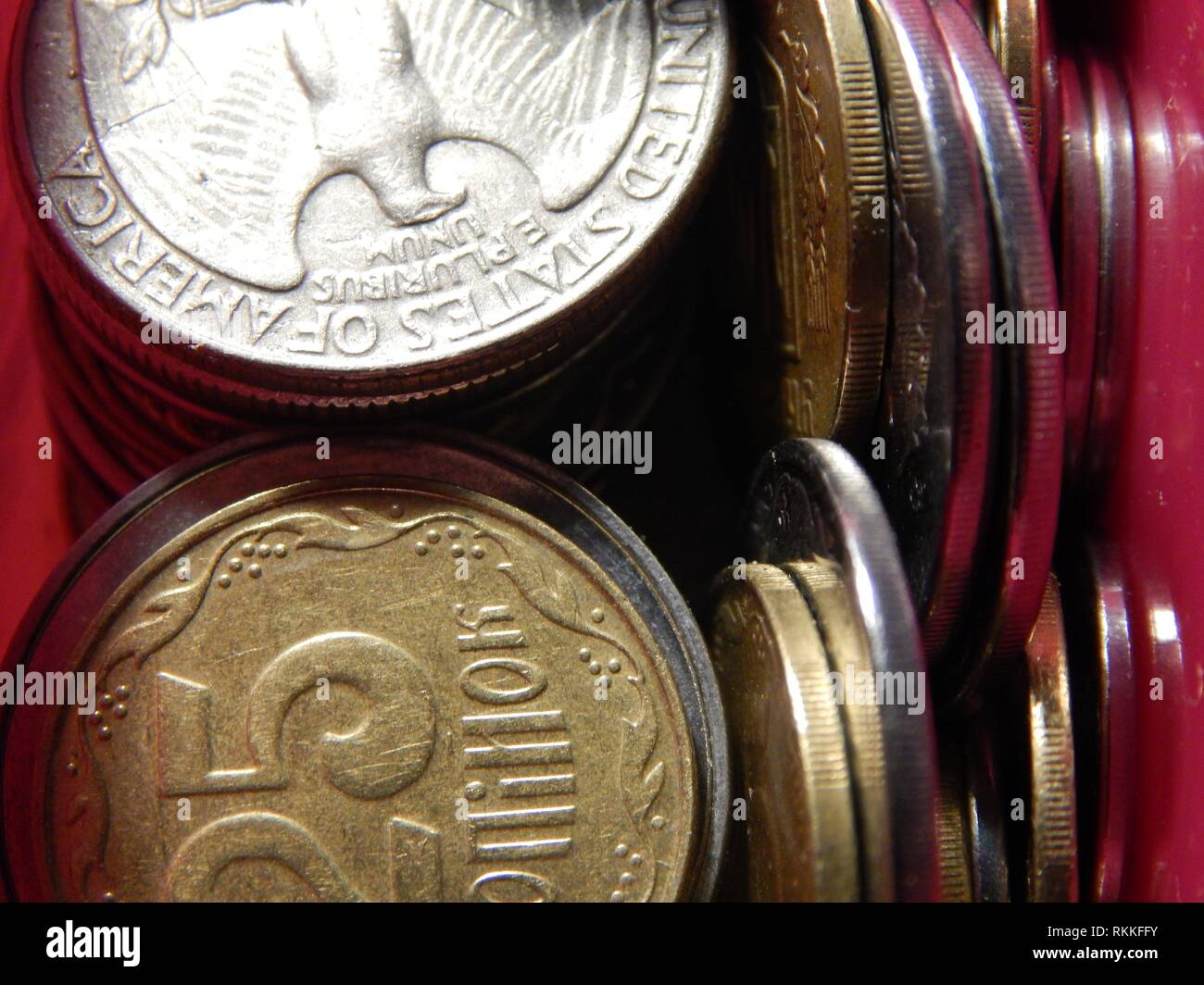 Numismatics, collecting coins of different countries and denominations. - Stock Image