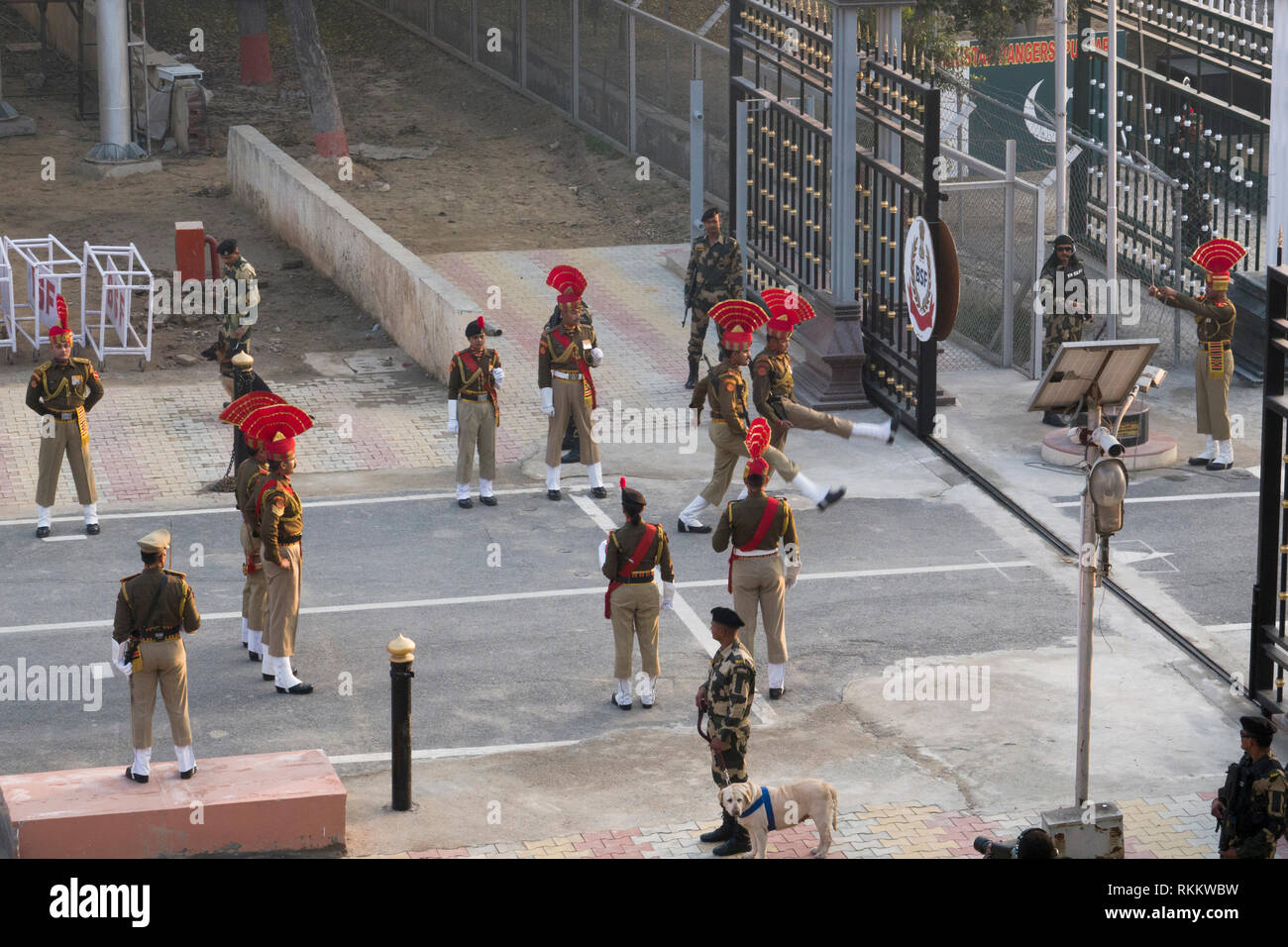 Indian soldiers perform in daily retreat ceremony at Wagah border in Punjab, India - Stock Image