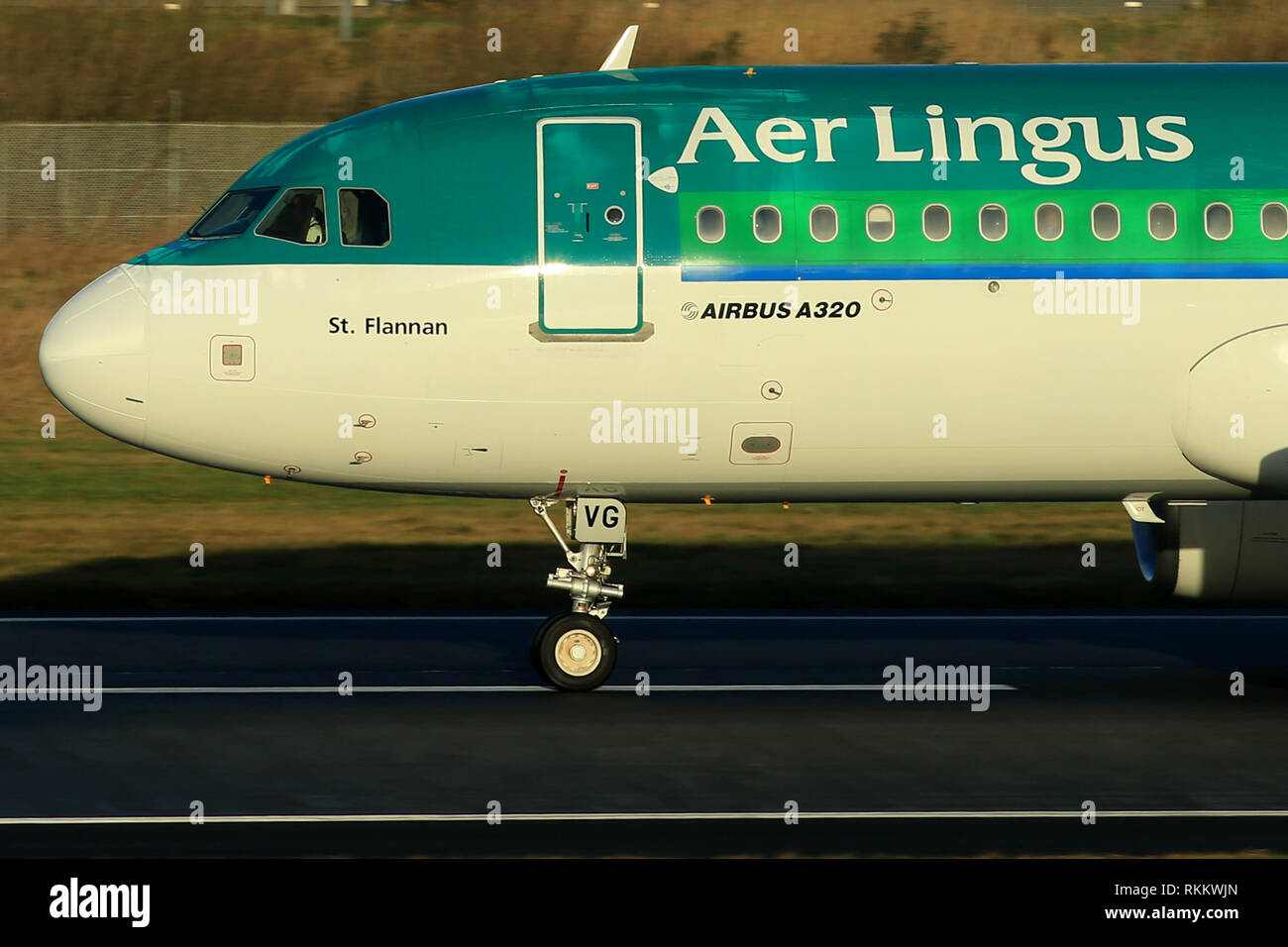 An Aer Lingus Airbus A320 prepares to take off from Belfast City Airport, Northern Ireland. The Airbus A320 family consists of short- to medium-range, narrow-body, commercial passenger twin-engine jet airlinersmanufactured by Airbus. The family includes the A318, A319, A320 and A321, as well as the ACJ business jet. The A320s are also named A320ceo (current engine option) after the introduction of the A320neo (new engine option) Final assembly of the family takes place in Toulouse, France, and Hamburg, Germany. A plant in Tianjin, China, has also been producing aircraft for Chinese airlines Stock Photo