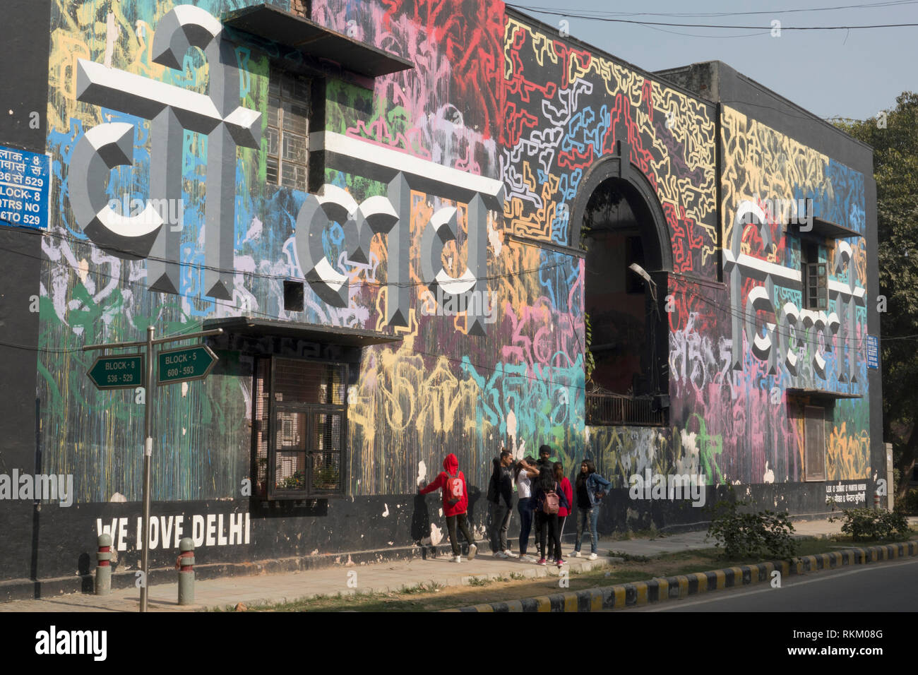 Group of teenagers in front of We Love Delhi street art mural, by artists Lek and Sowat in Lodhi colony, New Delhi, India - Stock Image