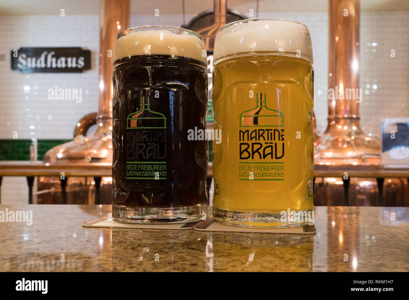 Martin's Brau craft brewery, Freiburg im Breisgau, Baden Wurttemberg, Germany - glasses of pils and dark beer - Stock Image