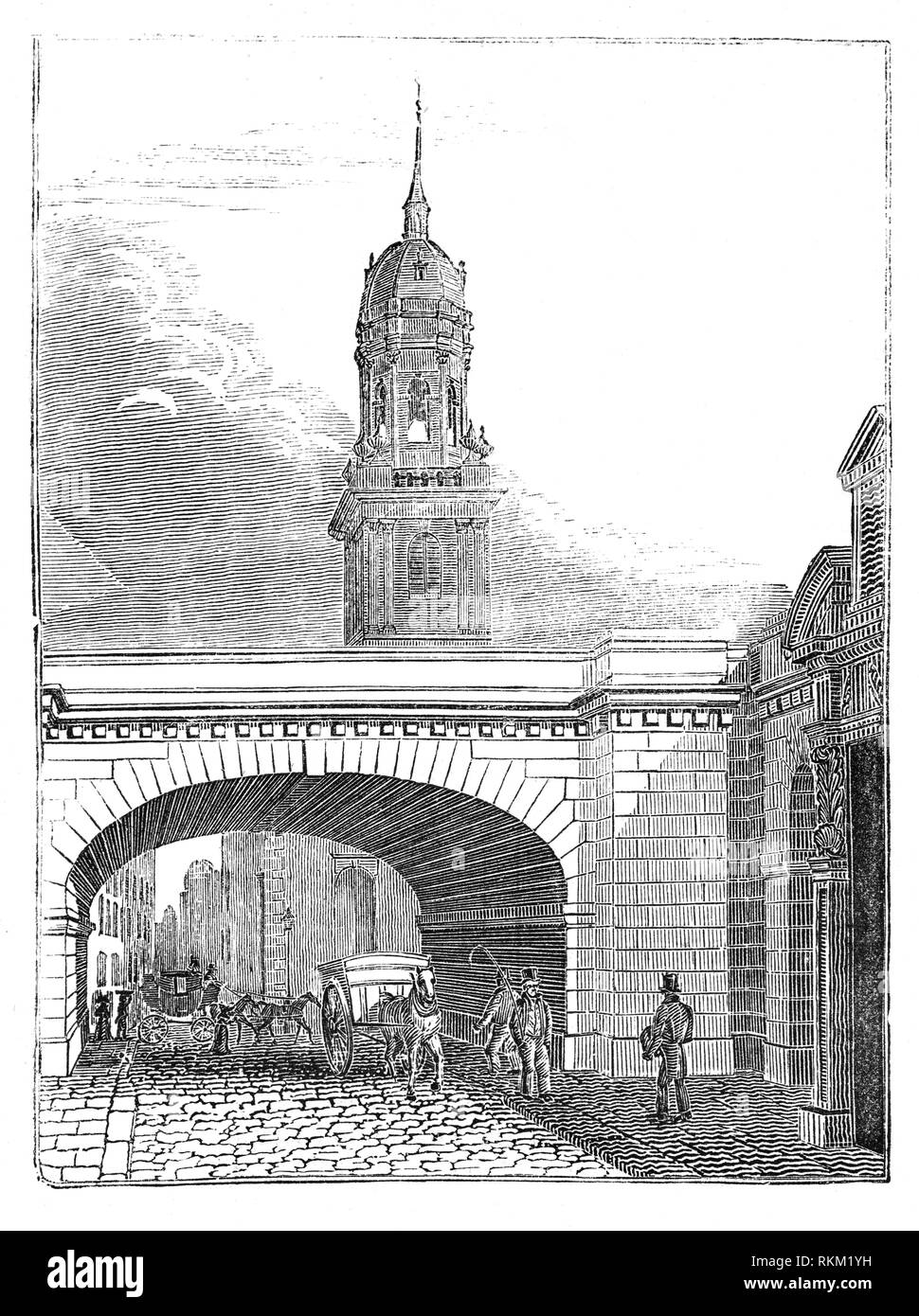 The clock tower, built in 1706, of St Magnus the Martyr on Lower Thames Street seen through an arch of the new London Bridge opened in 1831 from a design by John Rennie. - Stock Image