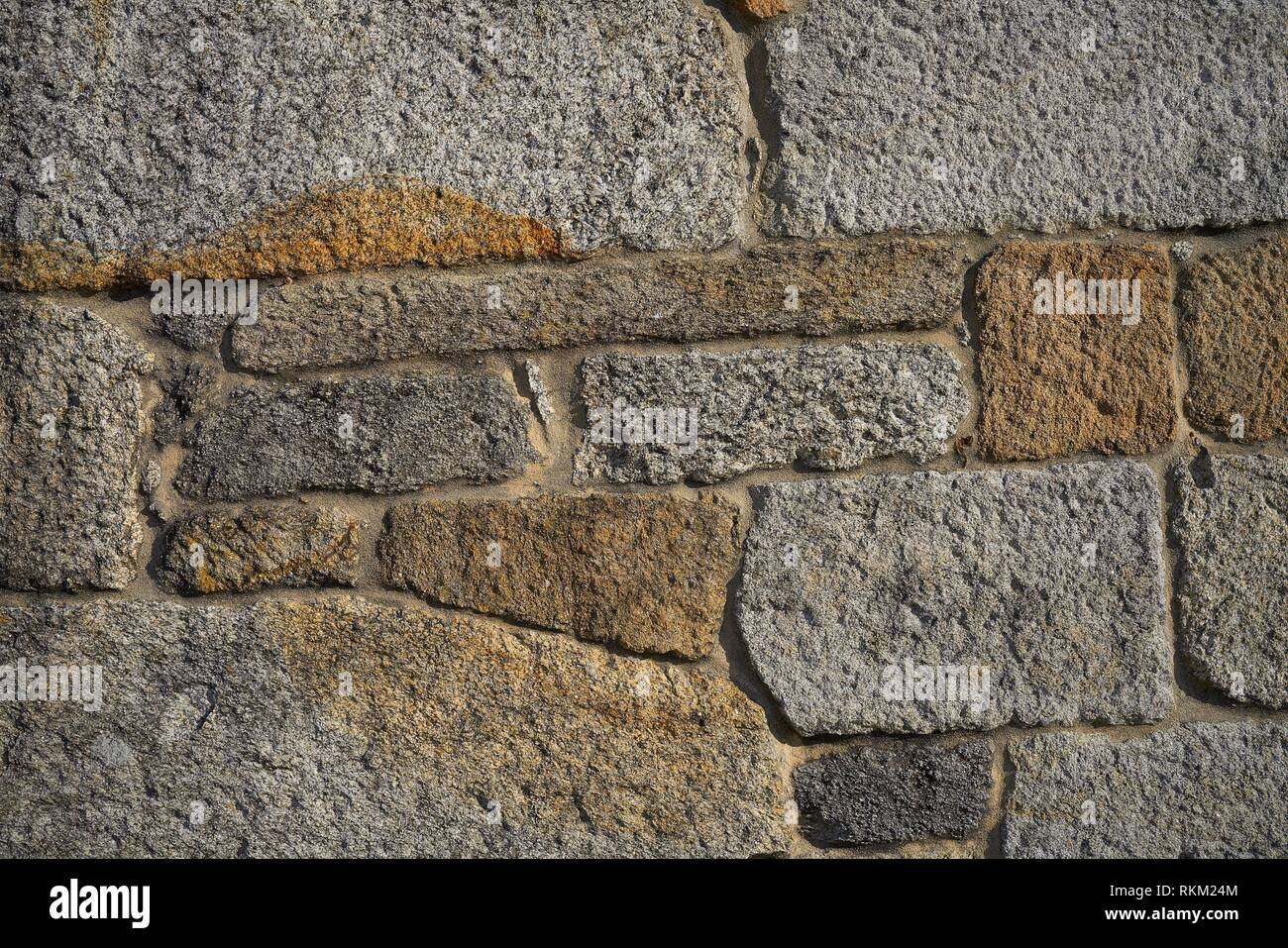 Granite stone bush hammered masonry wall in Galicia Spain. Stock Photo