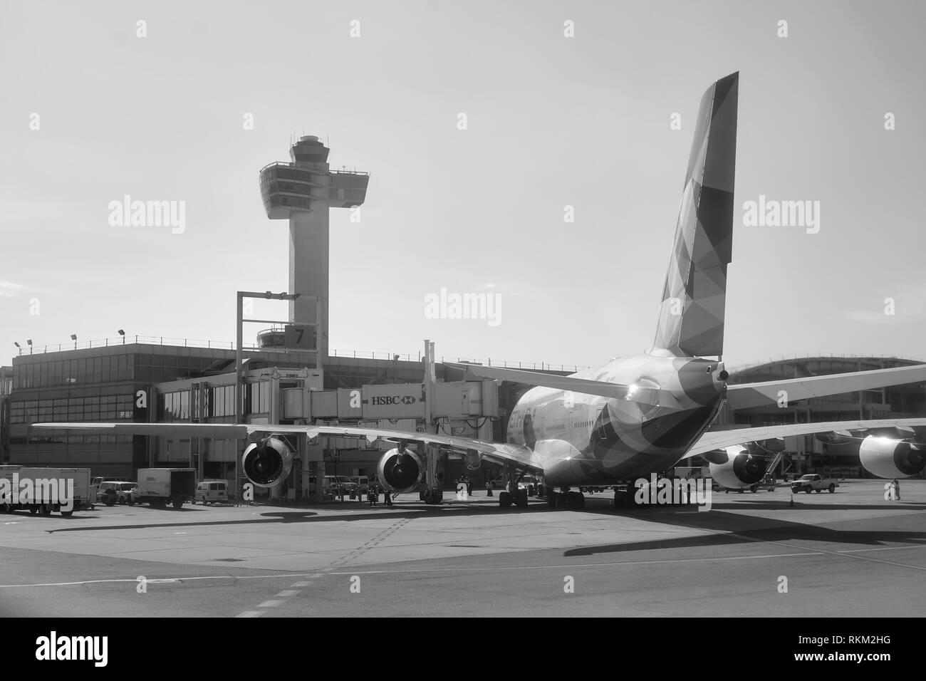 NEW YORK - MARCH 22, 2016: passenger jet airplane docked at JFK Airport. John F. Kennedy International Airport is a major international airport locate - Stock Image