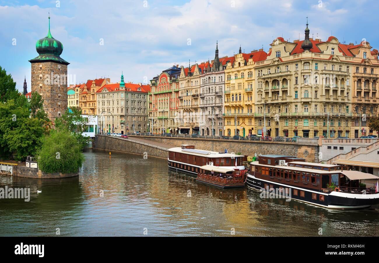 Embankment near Slavic island with Shytkovskaya water tower in Prague. - Stock Image