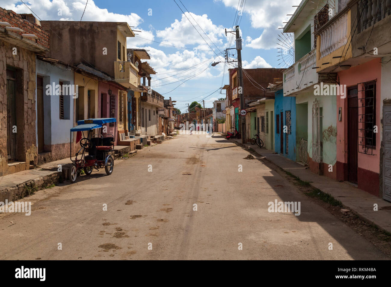 View at a street in Trinidad with typical tacky houses, Cuba - Stock Image